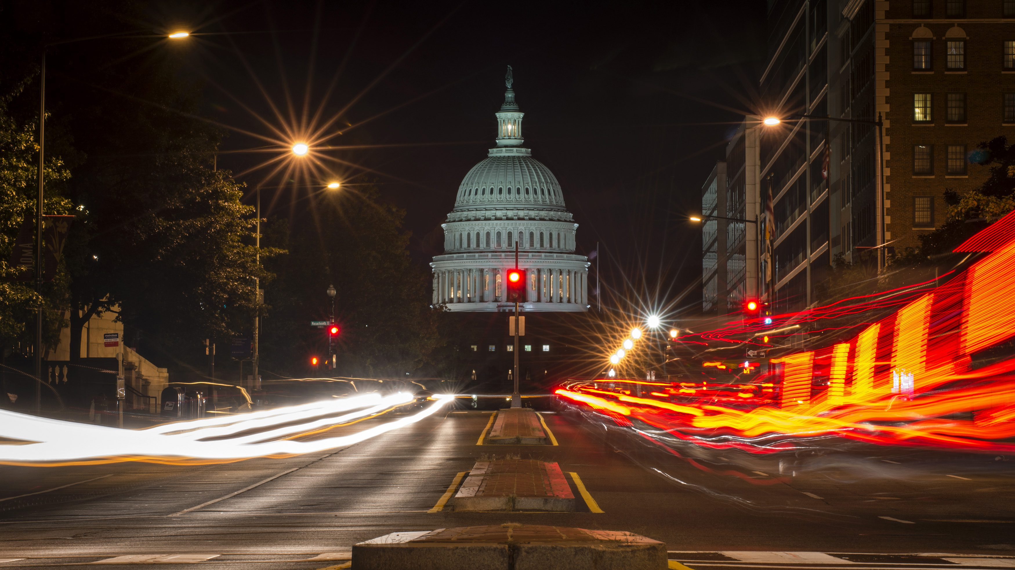 A red traffic light stands in front of the U.S. Capitol building in Washington September 30, 2013, approximately one hour before the U.S. federal government partially shut down after lawmakers failed to compromise on an emergency spending bill.
