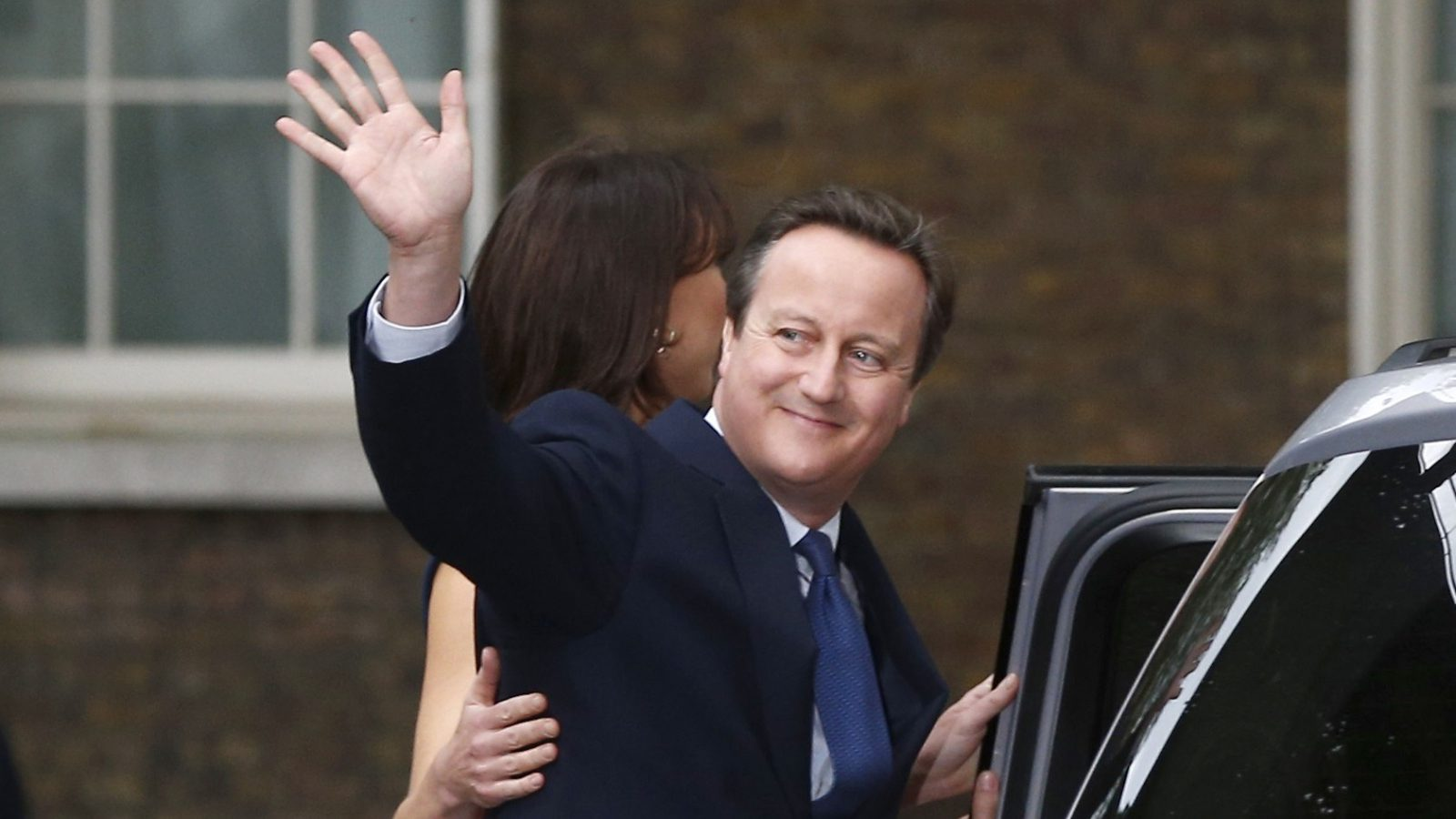 David Cameron waves.