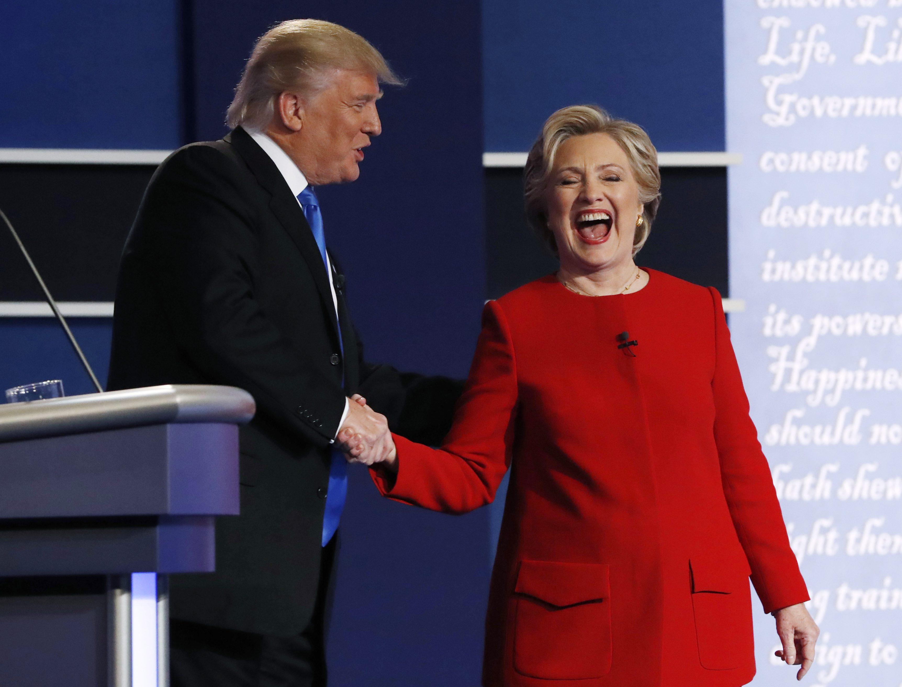 Republican U.S. presidential nominee Donald Trump greets Democratic U.S. presidential nominee Hillary Clinton after their first presidential debate at Hofstra University in Hempstead, New York, U.S., September 26, 2016.