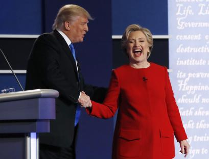 Republican U.S. presidential nominee Donald Trump greets Democratic U.S. presidential nominee Hillary Clinton after their first presidential debate at Hofstra University in Hempstead, New York, U.S., September 26, 2016.