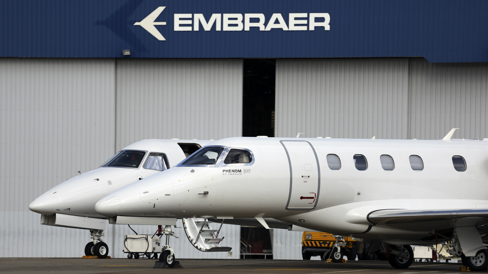 Private jets are seen at the Embraer headquarters in Sao Jose dos Campos, 100 km (62 miles) from Sao Paulo May 14, 2013. Brazil's barriers to international trade are limiting its growth potential and could hamper a huge infrastructure push at the center of President Dilma Rousseff's industrial agenda, the head of the U.S. Commerce Department said in a Tuesday interview. Acting Commerce Secretary Rebecca Blank suggested the advantages given to Brazilian industries through import taxes and restrictions on government-led investments may even slow the development of globally competitive companies.