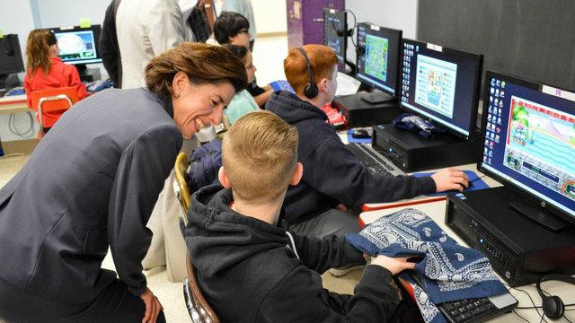 Gina Raimondo and kids at computers