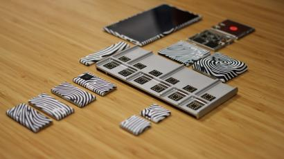 A Google Project Ara smartphone with modules scattered around it