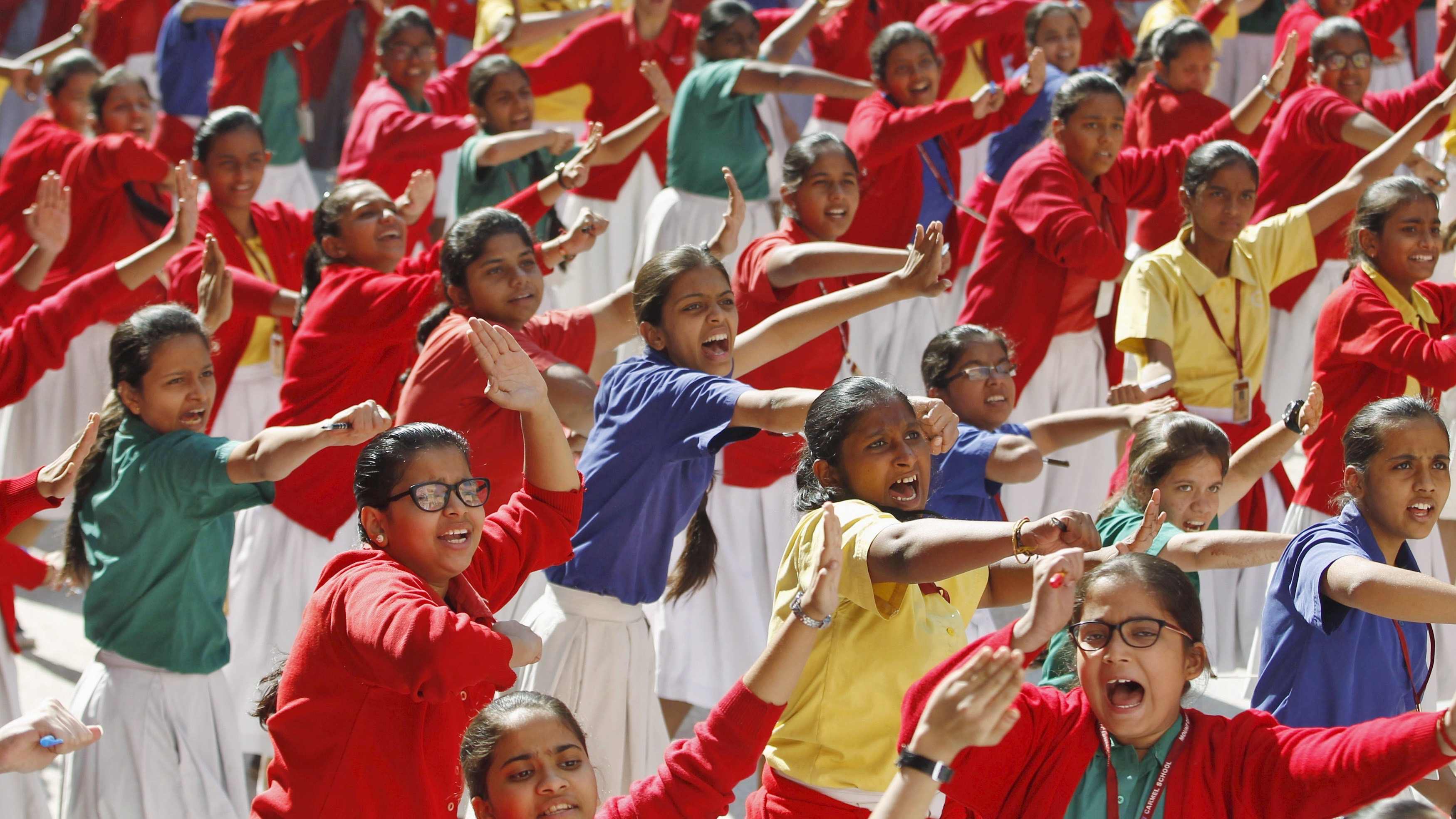 Schoolgirls practice martial arts during an event in Ahmedabad, India, December 16, 2015, to mark the third anniversary of the fatal gang rape of a woman on a Delhi bus in December 2012. REUTERS/Amit Dave - RTX1YXB1