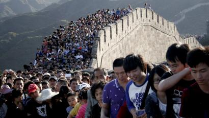 Tourists gather on the Great Wall outside Beijing