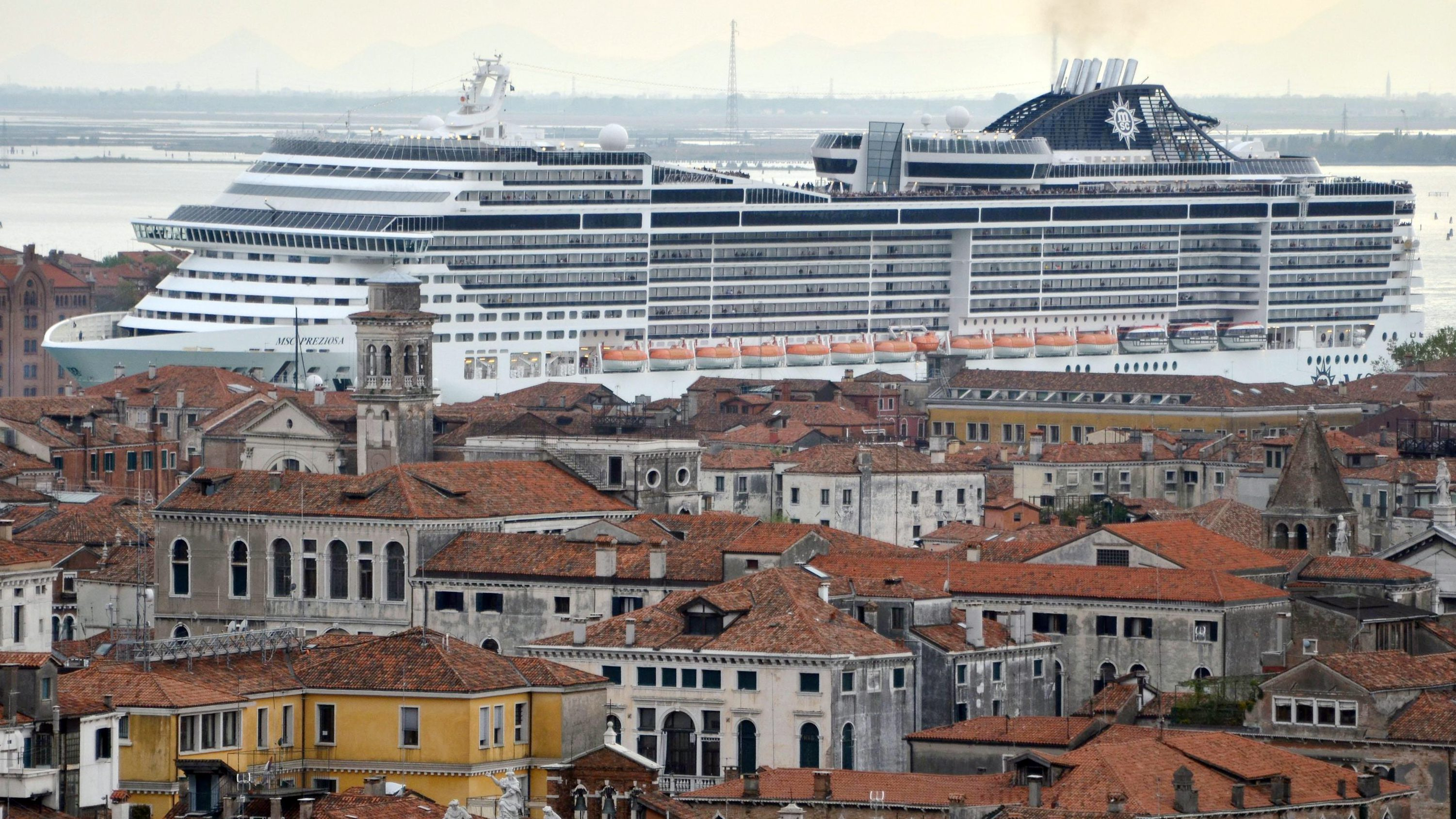 A file photo dated 05 April 2014 shows the cruise ship 'MSC Preziosa' navigating in the Canale della Giudecca, in Venice, Italy. Media reports on 16 July 2016, that the UNESCO World Heritage Committee has threatened to put Venice on their list of endangered heritage sites on 14 July 2016, if authorities fail to ban big cruise liner from the lagoon by 2017. The 40th World Heritage Committee meets in Istanbul from 10 to 20 July 2016.