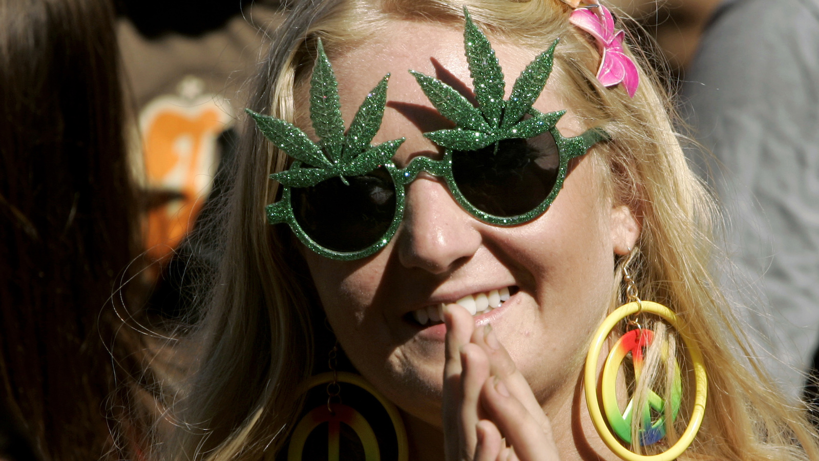 """A fan listens to music during the """"Summer of Love"""" 40th anniversary concert at Golden Gate Park in San Francisco"""