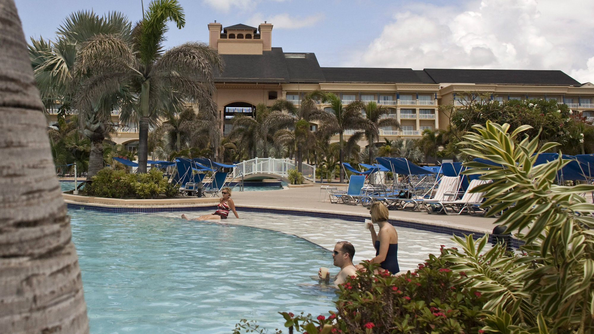 People by swimming pool in luxury hotel
