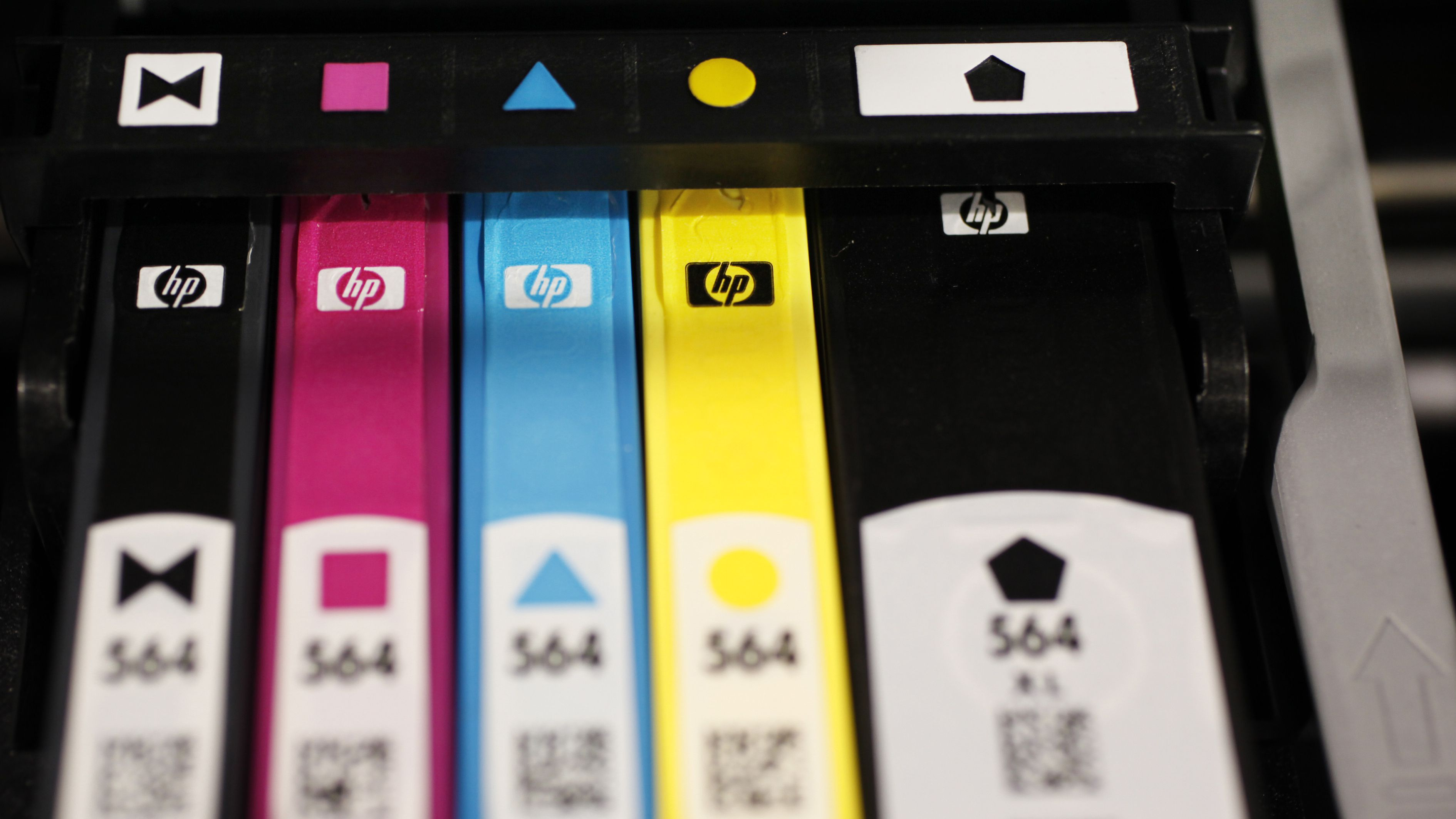 Hewlett Packard printer inks are seen inside an HP printer on display at Best Buy in Mountain View, Calif., Monday, May 18, 2009. Hewlett-Packard Co. on Tuesday said its quarterly profit dropped 17 percent as sales of personal computers and printer ink slumped. The numbers were still in line with Wall Street's forecasts. (AP Photo/Paul Sakuma)