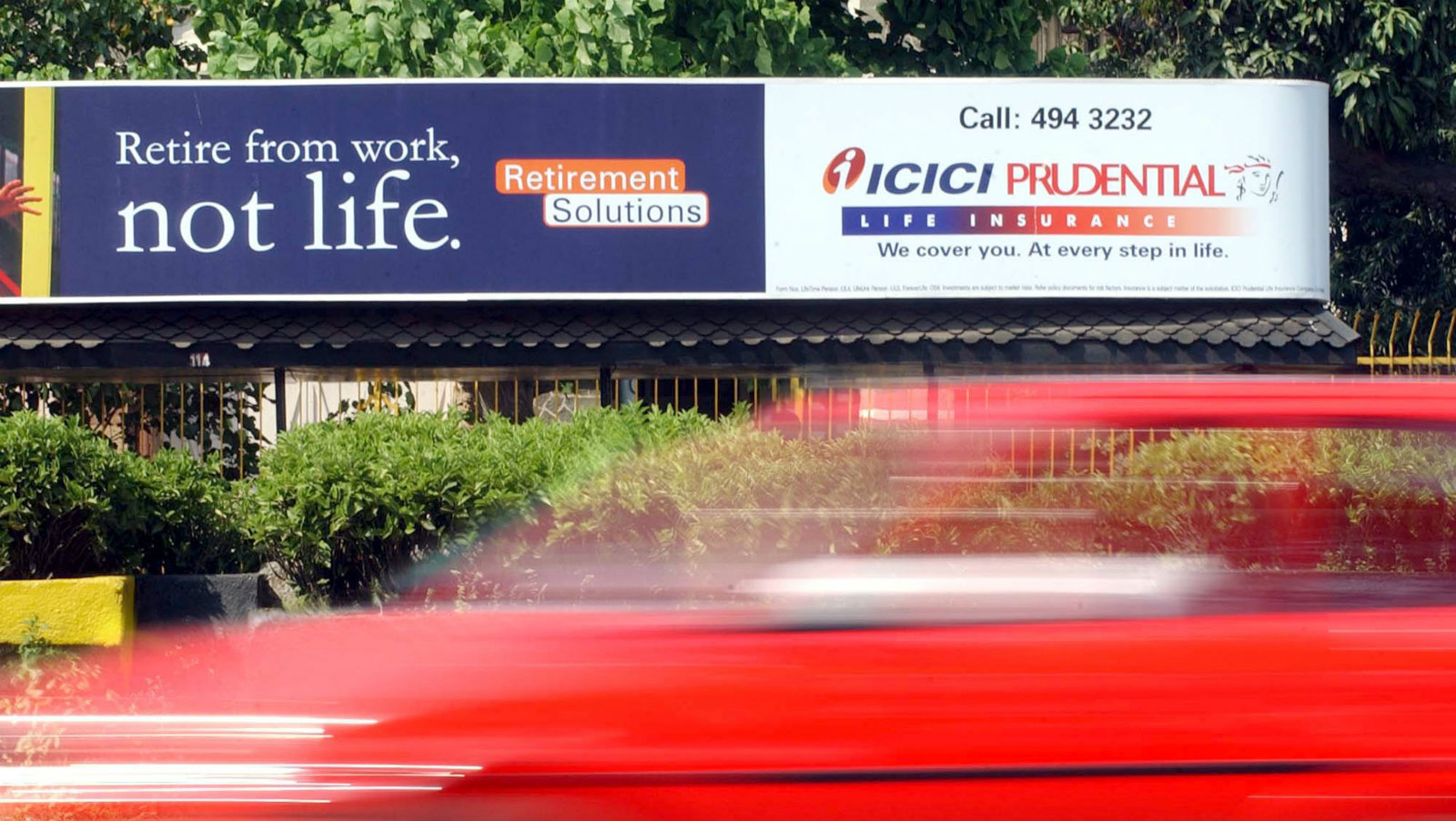 A vehicle passes a life insurance bill board of Prudential-ICICI, in Bombay September 30, 2002. Life insurance Prudential PLC (PUK) said on Monday that it would cut 805 jobs - or 11% of its U.K. workforce - and outsource functions to a new offshore call center in India, in a continued effort to cut costs. ICICI is the Indian partner of Prudential PLC (PUK).