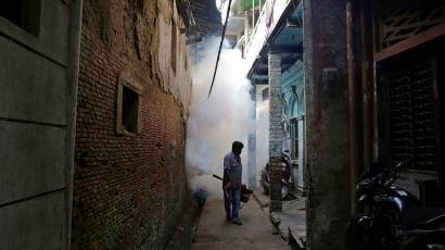 An Indian health worker fumigates an area in order to prevent the spread of mosquito-borne diseases in Allahabad, India, Wednesday, Sept. 14, 2016. Despite efforts, including spraying vast areas with clouds of diesel smoke and insecticide, several Indian cities battle dengue fever and other mosquito-borne diseases like chikungunya every year during and after the rainy season. (AP Photo/Rajesh Kumar Singh)