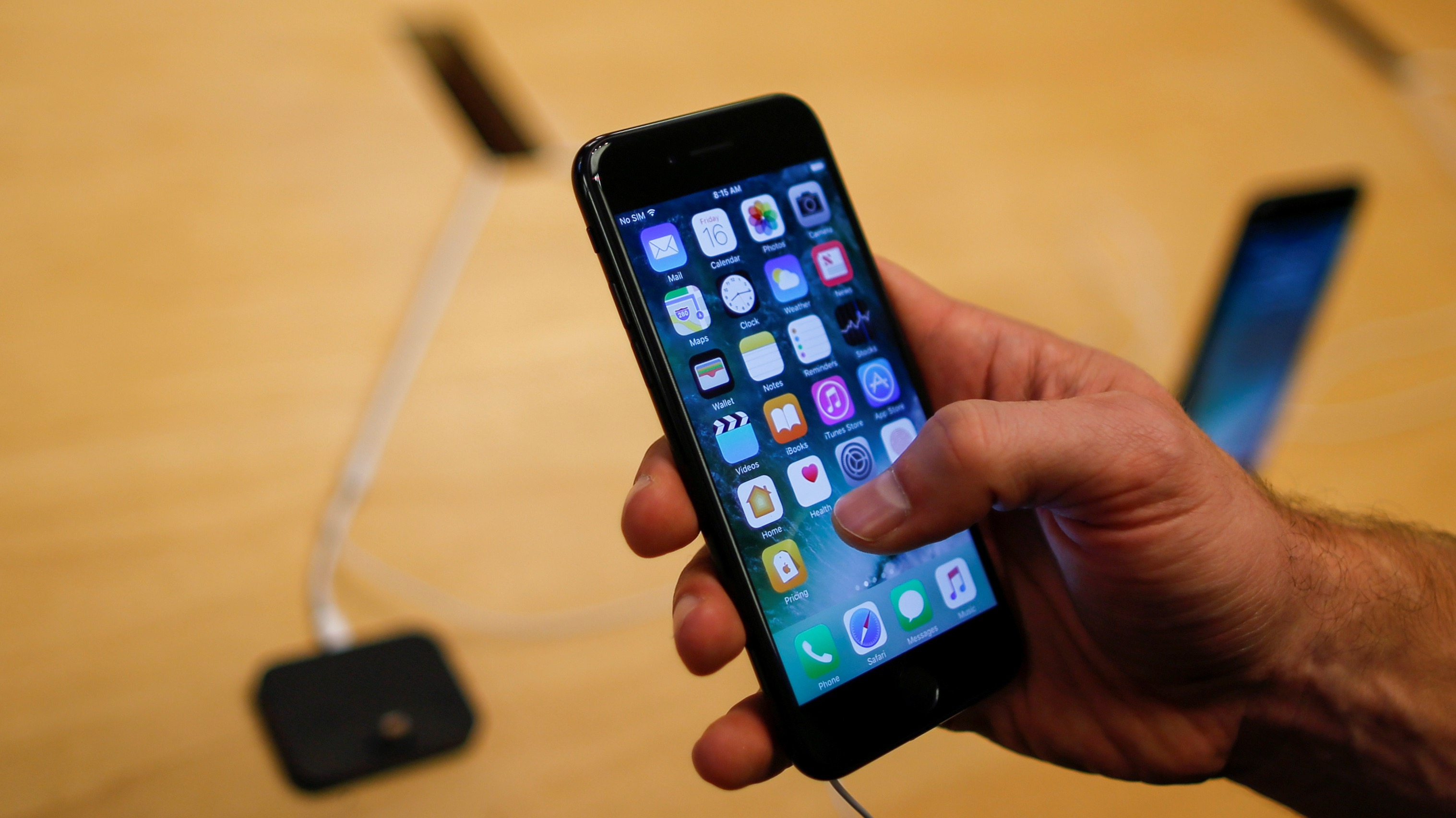 A guide to the new features in the ios 10 messages app for iphones a customer takes a look at the new iphone 7 smartphone inside of an apple inc buycottarizona Gallery