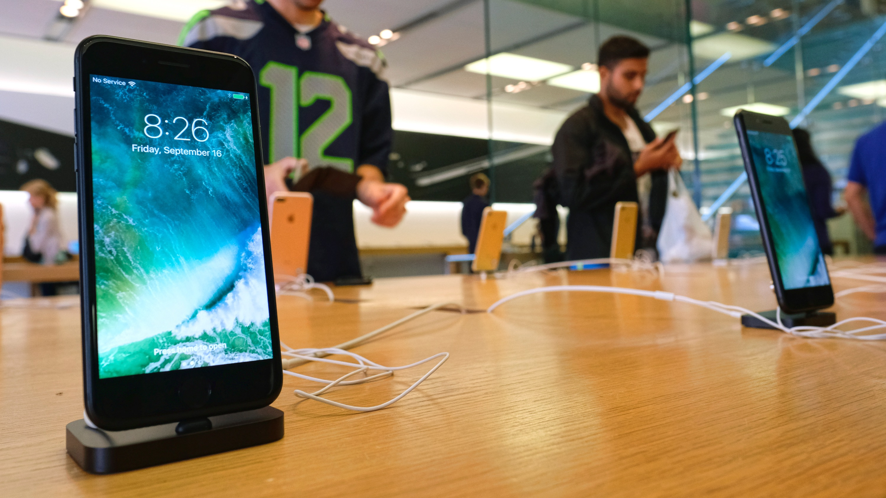 The new Apple iPhone 7 is displayed at the Apple Store at the Grove in Los Angeles on Friday, Sept. 16, 2016. The latest Apple Watches and iPhone 7 were released Friday. (AP Photo/Richard Vogel)