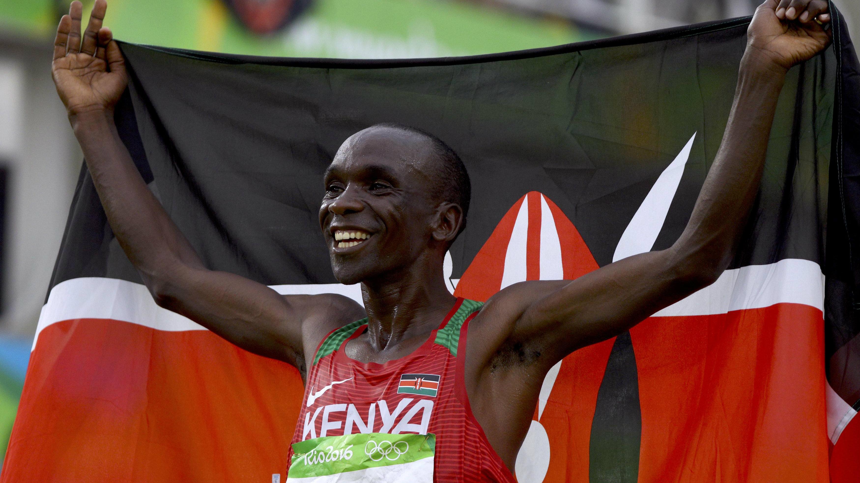Eliud Kipchoge (KEN) of Kenya celebrates after winning the race