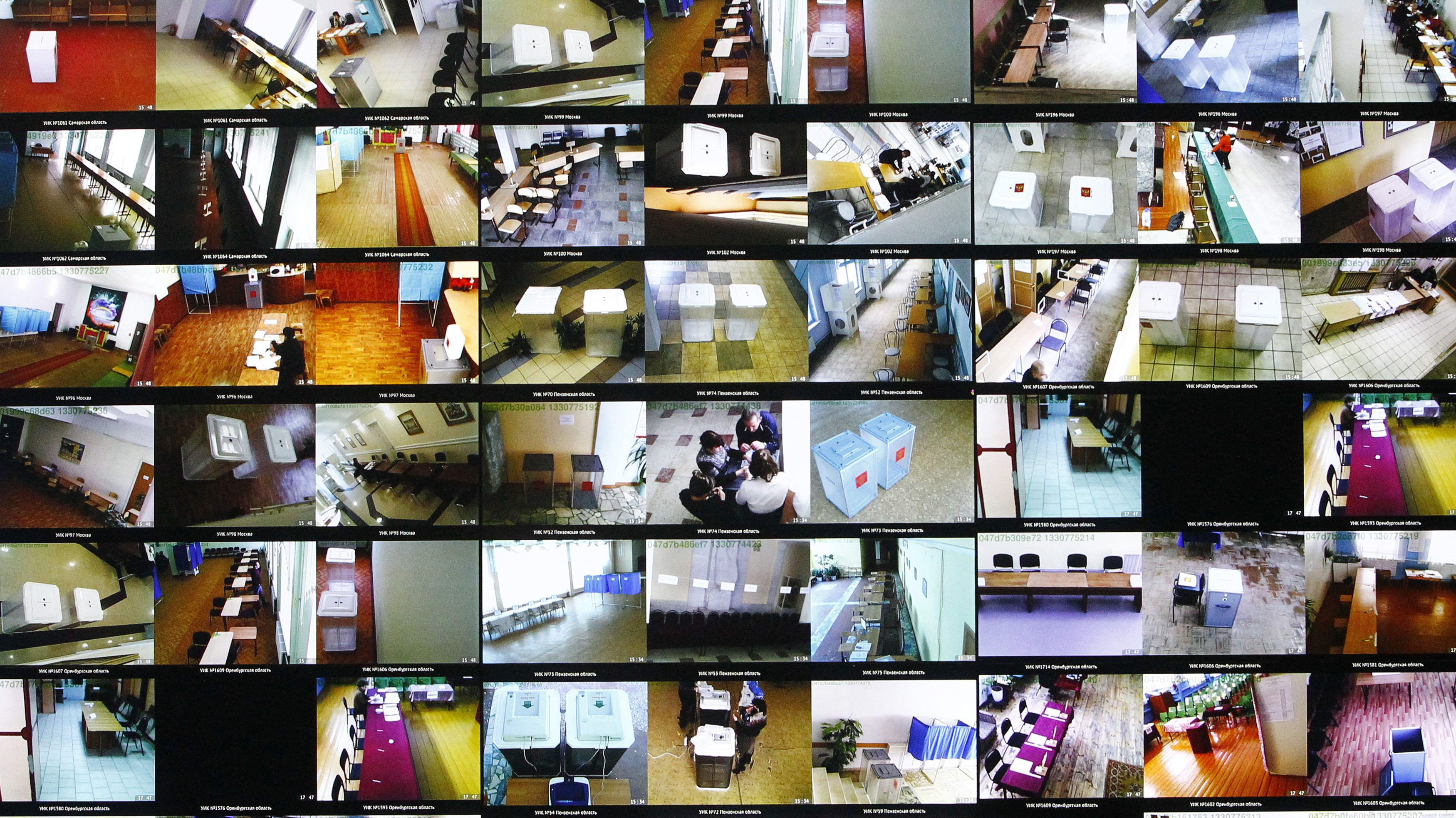 Screens showing live broadcast from polling stations via a network of webcams installed all over the country are seen during a presentation ceremony at the headquarters of the Chamber of Commerce and Industry of the Russian Federation in Moscow March 3, 2012. Russians will go to the polls for their presidential election on Sunday.
