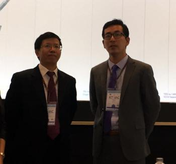 China Space Agency administrator Wu Yanhua and Landspace CEO Zhang Changwu confer at the International Astronautical Congress.
