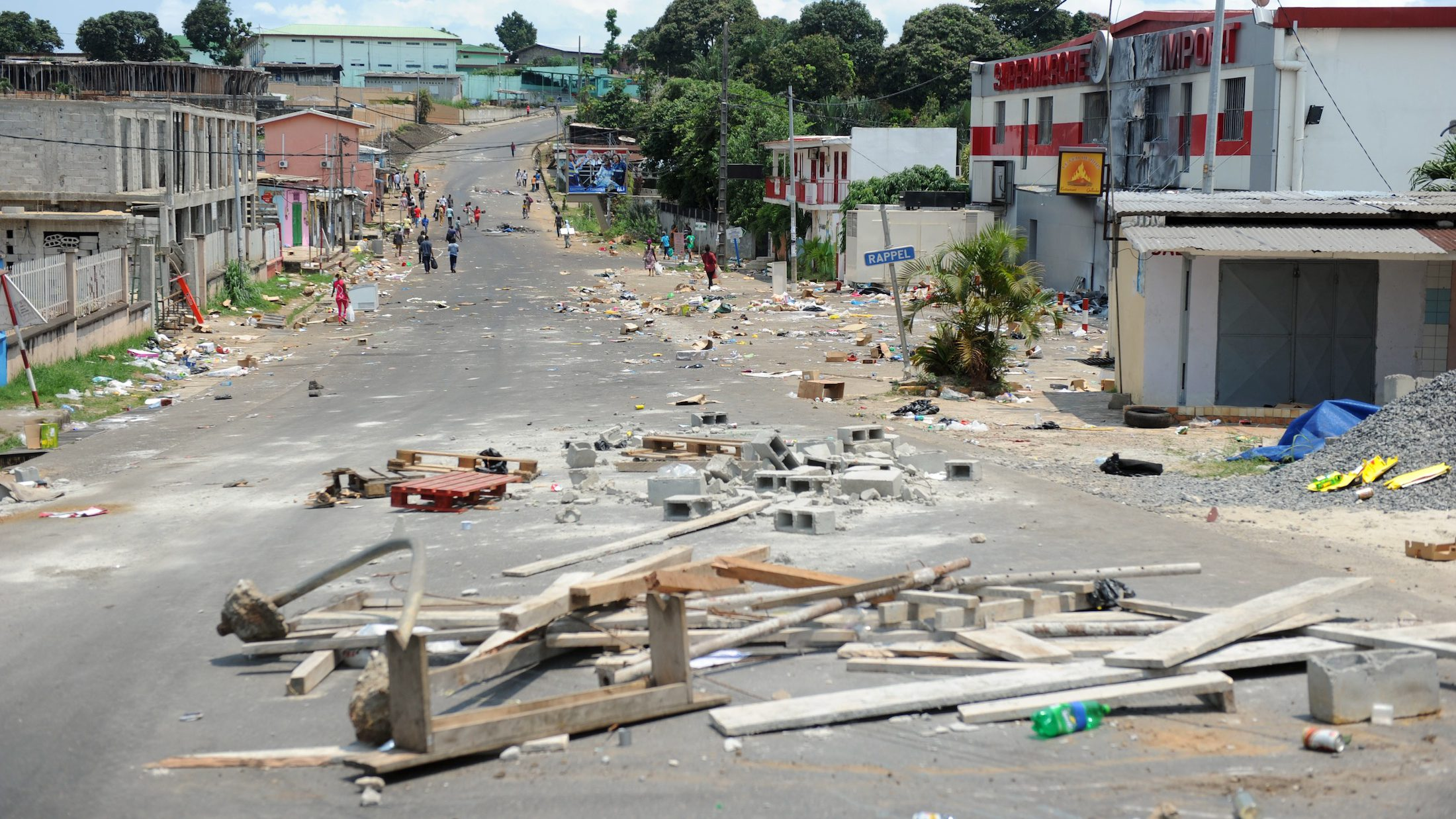 Barricades are seen  on a street  following an election protest in Libreville.