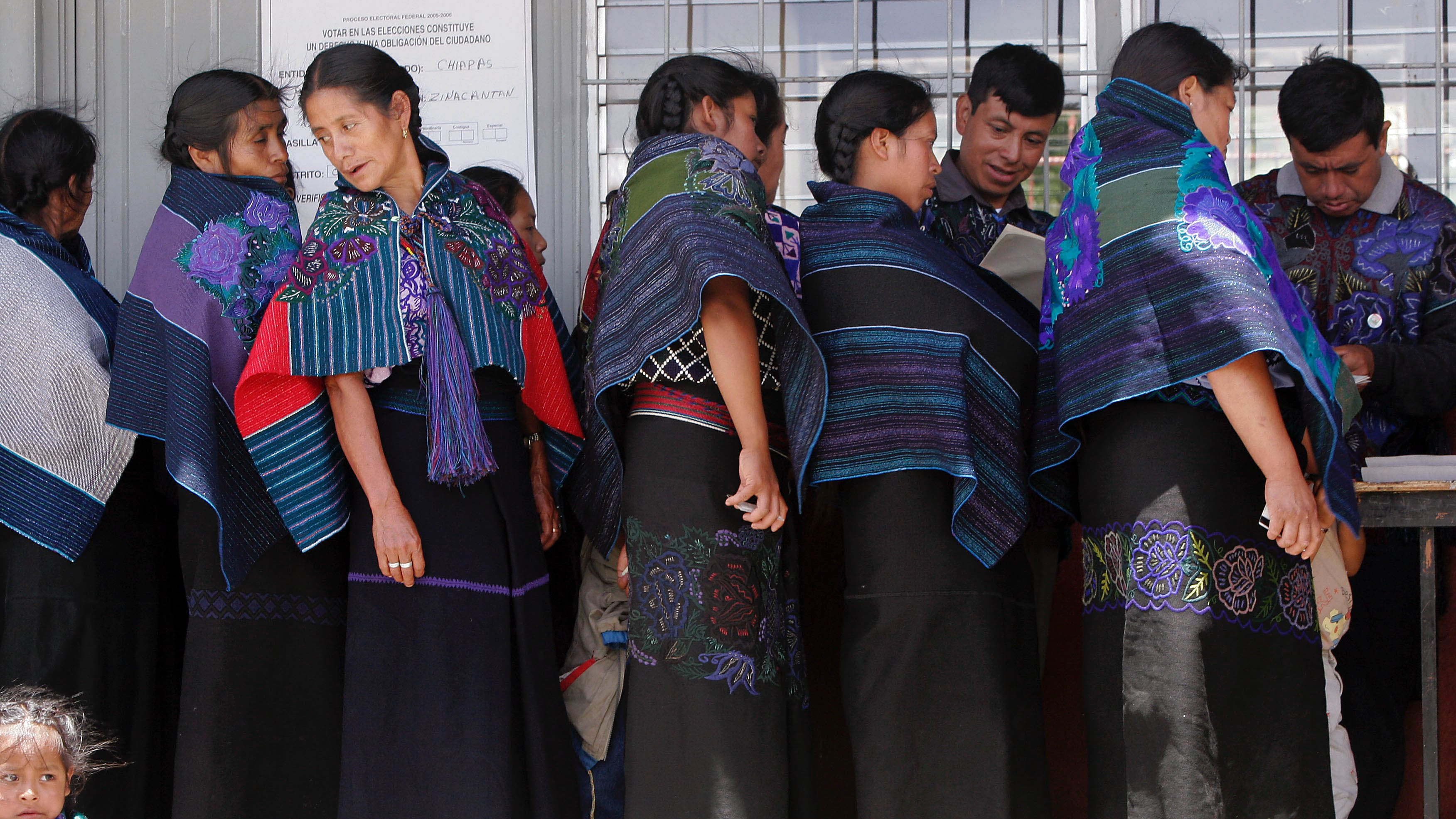Tzotzil indigenous women  line up to vote  during presidential elections in the southern state of Chiapas, Mexico.