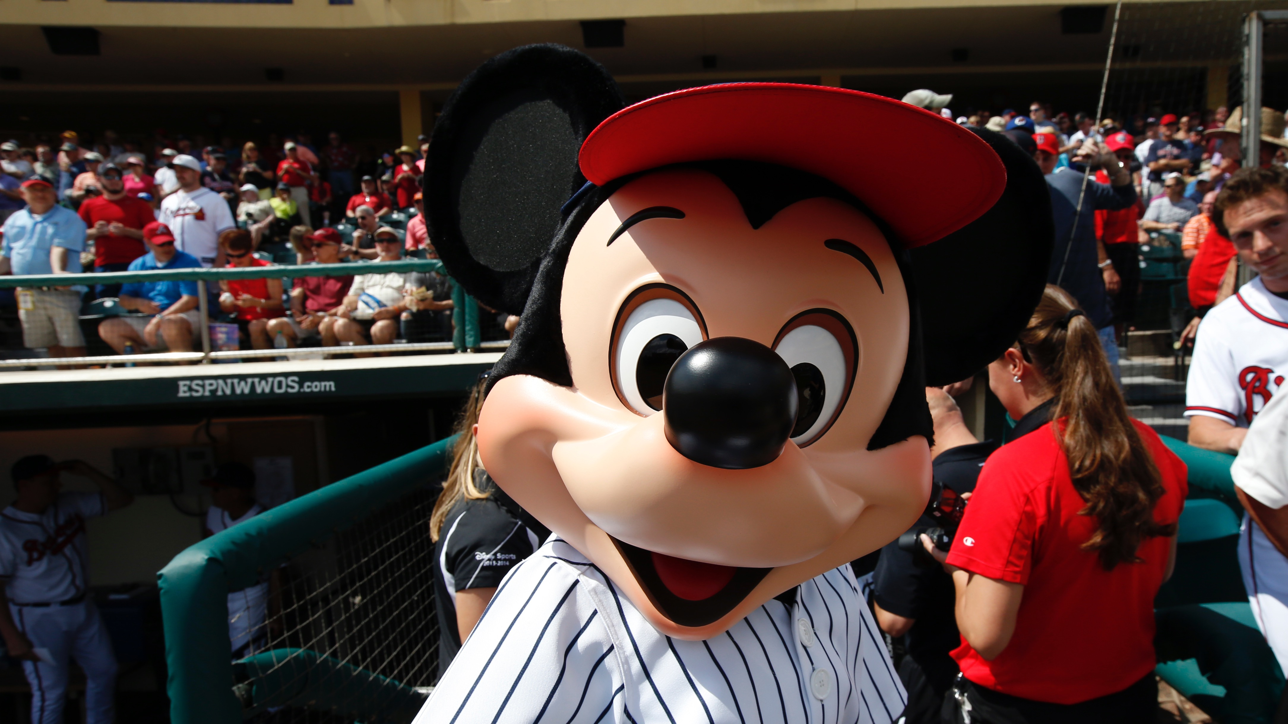 Mickey Mouse wears pinstripes before a spring exhibition baseball game between the Washington Nationals and the Atlanta Braves, Tuesday, March 4, 2014, in Kissimmee, Fla. (AP Photo/Alex Brandon)