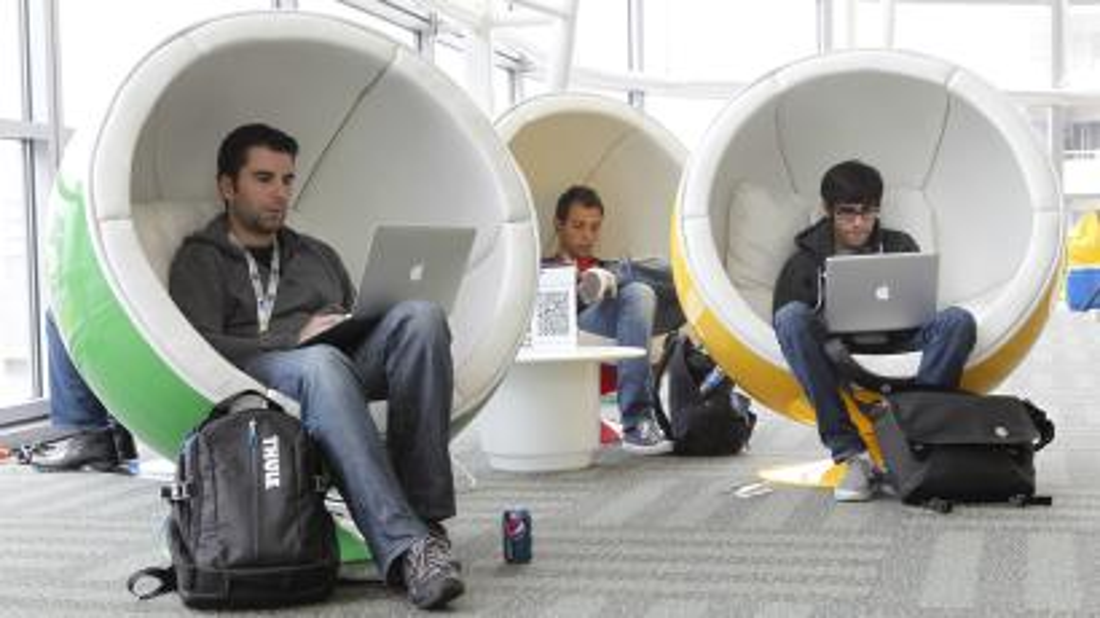 Millennials in silly work chairs