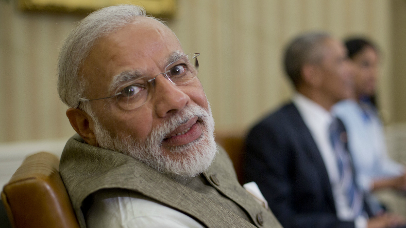 Indian Prime Minister India Narendra Modi looks over his shoulder to speak with an aide during his meeting with President Barack Obama in the Oval Office of the White House in Washington, Tuesday, June 7, 2016.