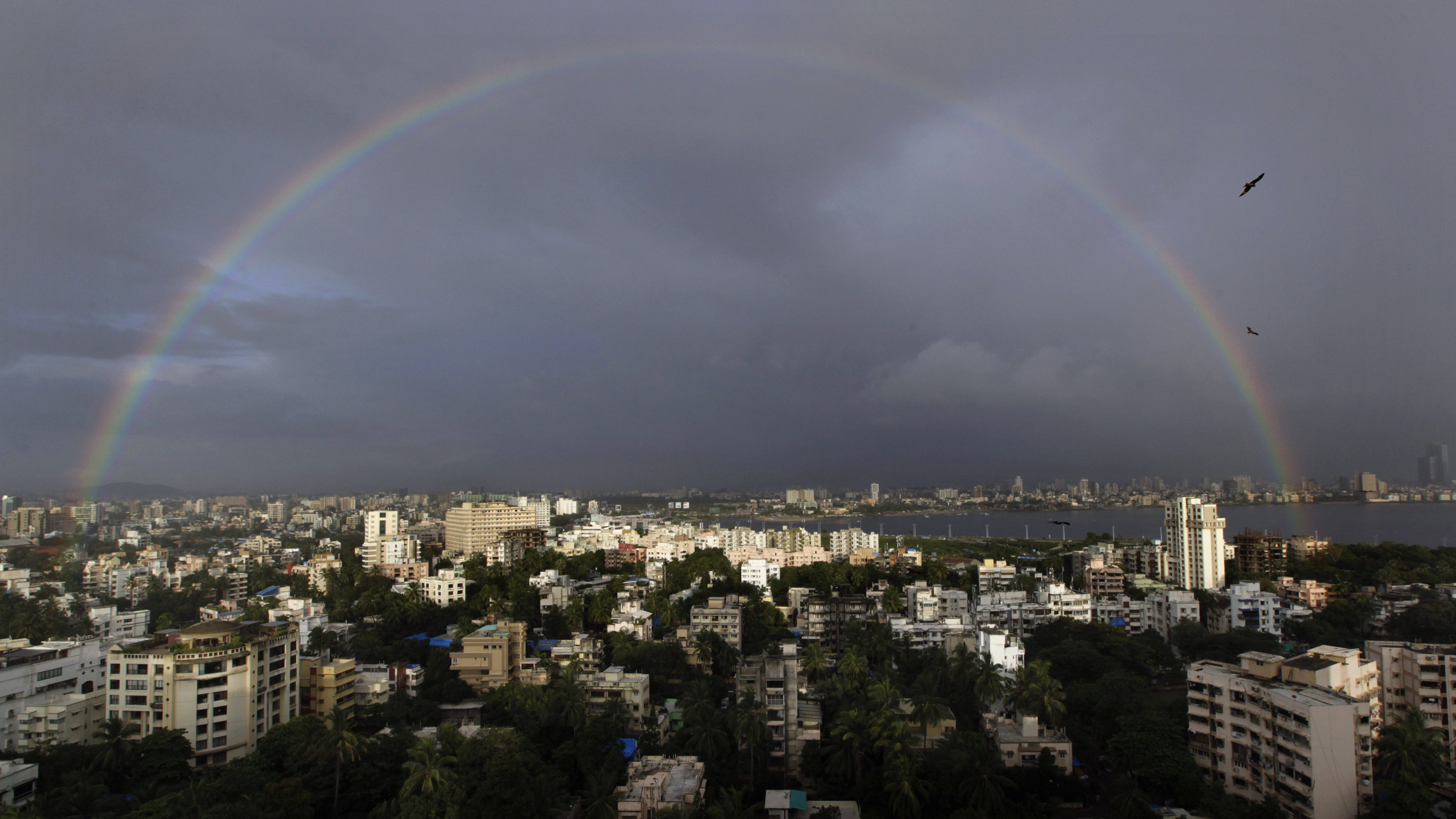 A rainbow is seen over the skyline after two days of heavy rainfall in Mumbai India, Friday, Sept. 7, 2012. (AP Photo/ Manish Swarup)