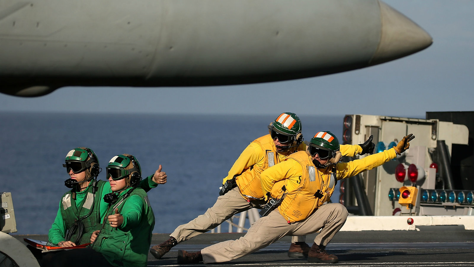 A flight deck crew prepares to launch a F18 Super Hornet from the deck of the USS Eisenhower in the Atlantic Ocean off the coast of Virginia. US secretary Ash Carter visited the carrier with India's defence minister Manohar Parrikar to see a demonstration of the US Navy aircraft carrier's flight operations.