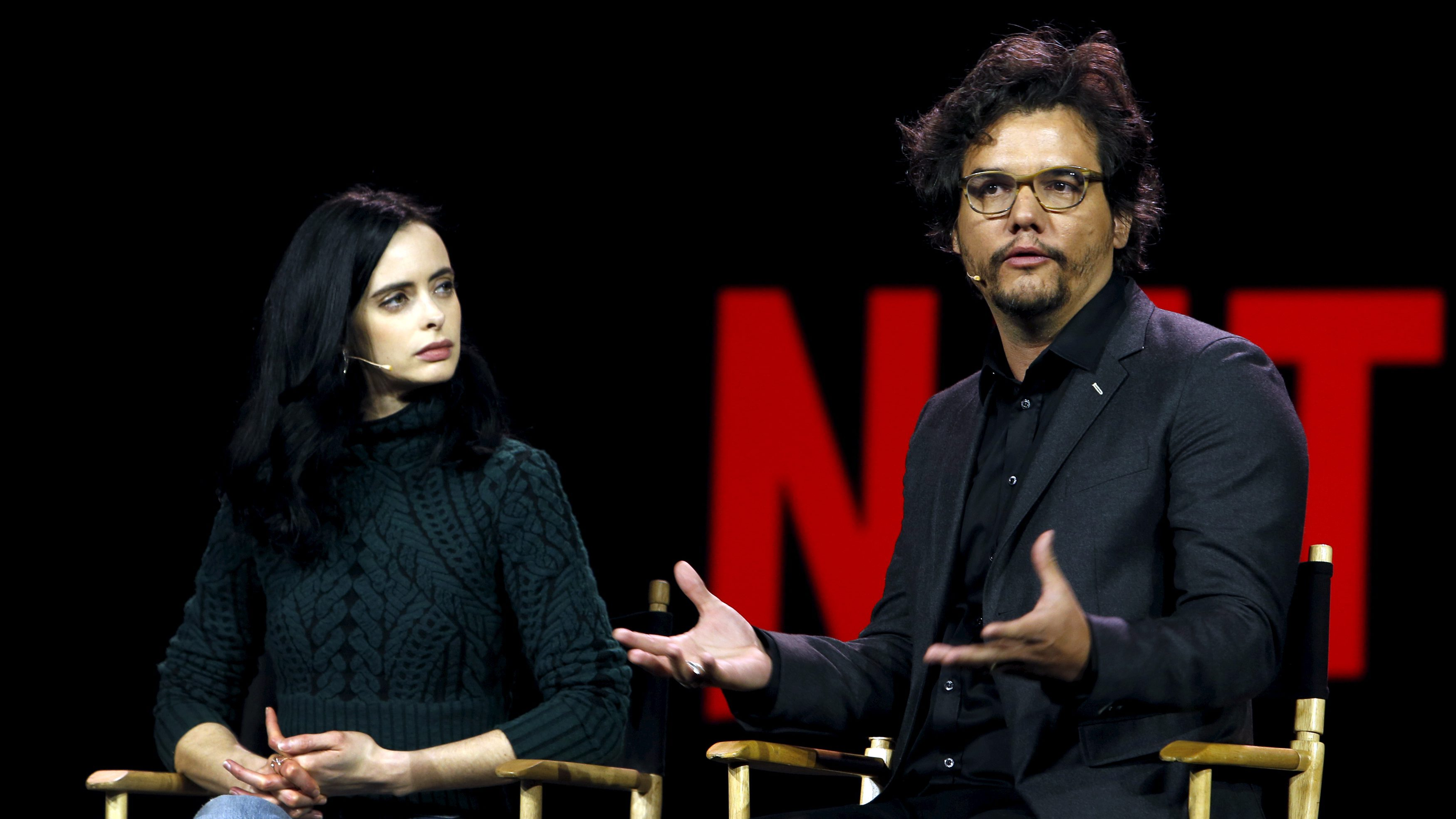 Actress Krysten Ritter (L) listens to Brazilian actor Wagner Moura during a Netflix keynote address at the 2016 CES trade show in Las Vegas, Nevada, January 6, 2016.