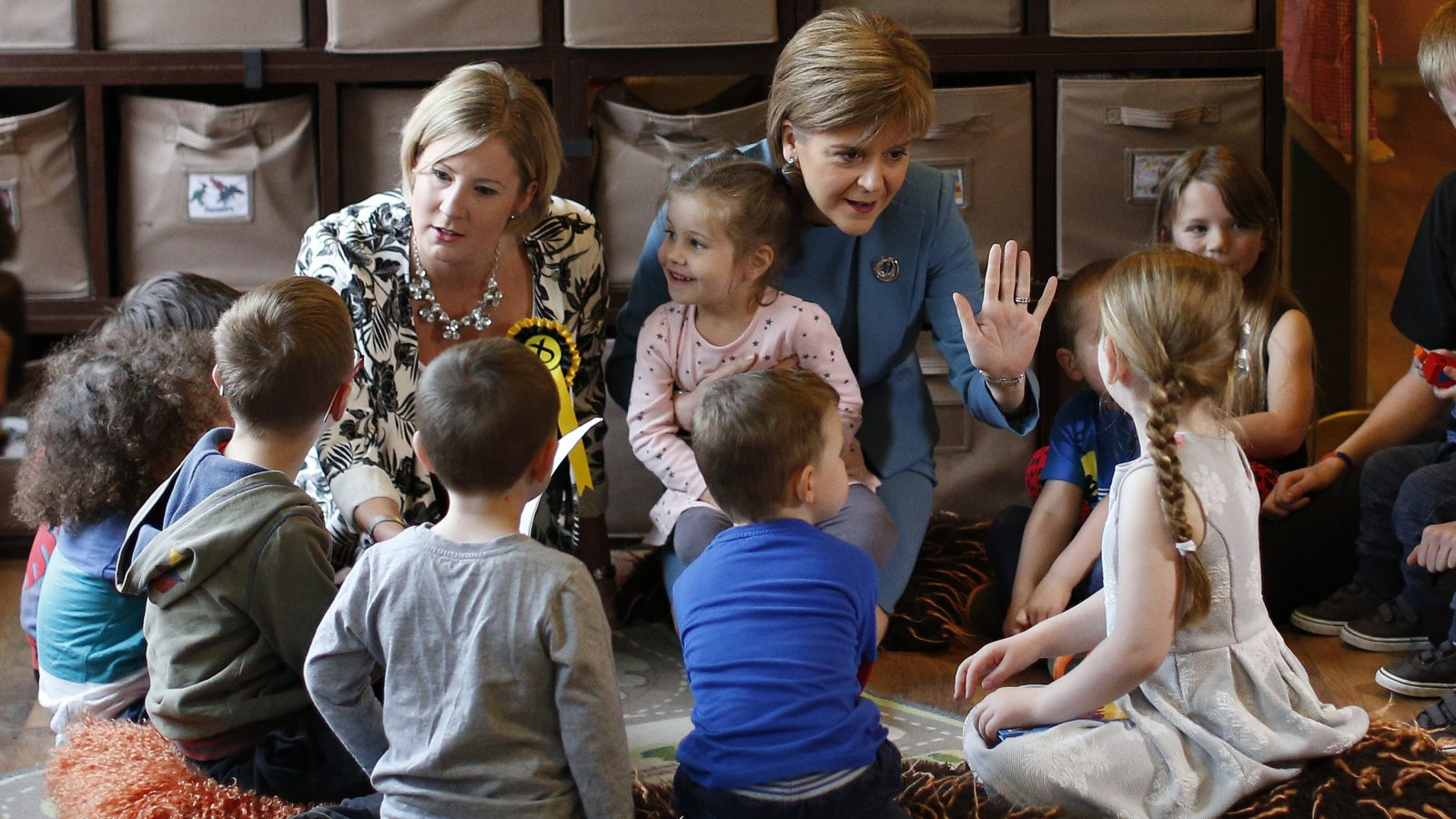 Nicola Sturgeon, leader of the Scottish National Party, gestures to children during an election visit to the ABC Nursery in Livingston, Britain May 5, 2015. Britain will go to the polls in a national election on May 7. REUTERS/Russell Cheyne - RTX1BMFU