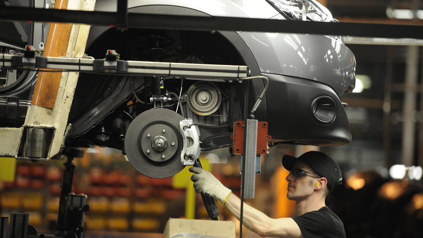 A Nissan technician prepares a Qashqai car at the company's plant in Sunderland, UK.