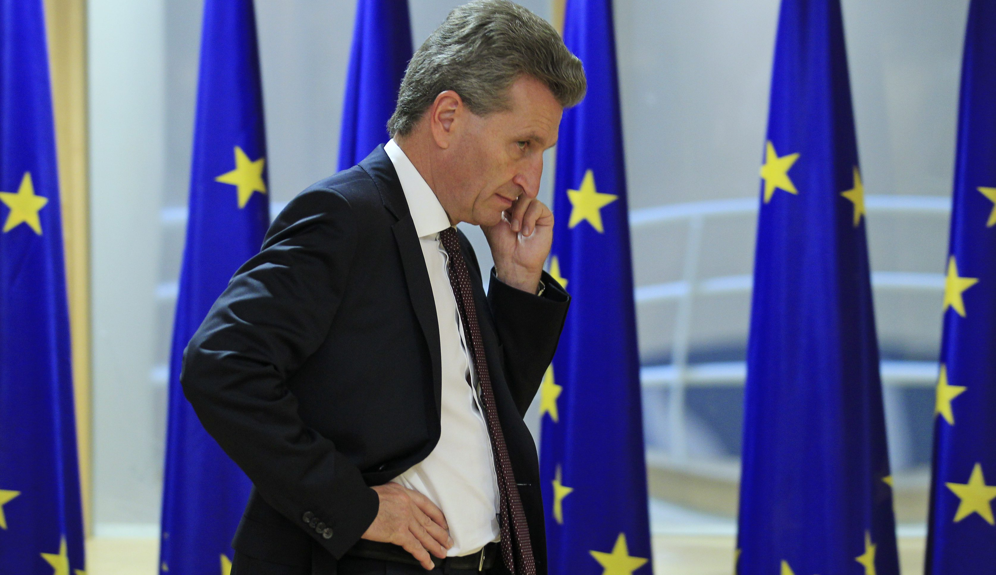 European Energy Commissioner Gunther Oettinger talks on his cell phone ahead of a meeting of the European Commission and an Irish ministers delegation in Brussels October 3, 2012. Europe's nuclear reactors need investment of 10-25 billion euros, a draft European Commission report said, following a safety review designed to ensure a disaster like Japan's Fukushima cannot happen.