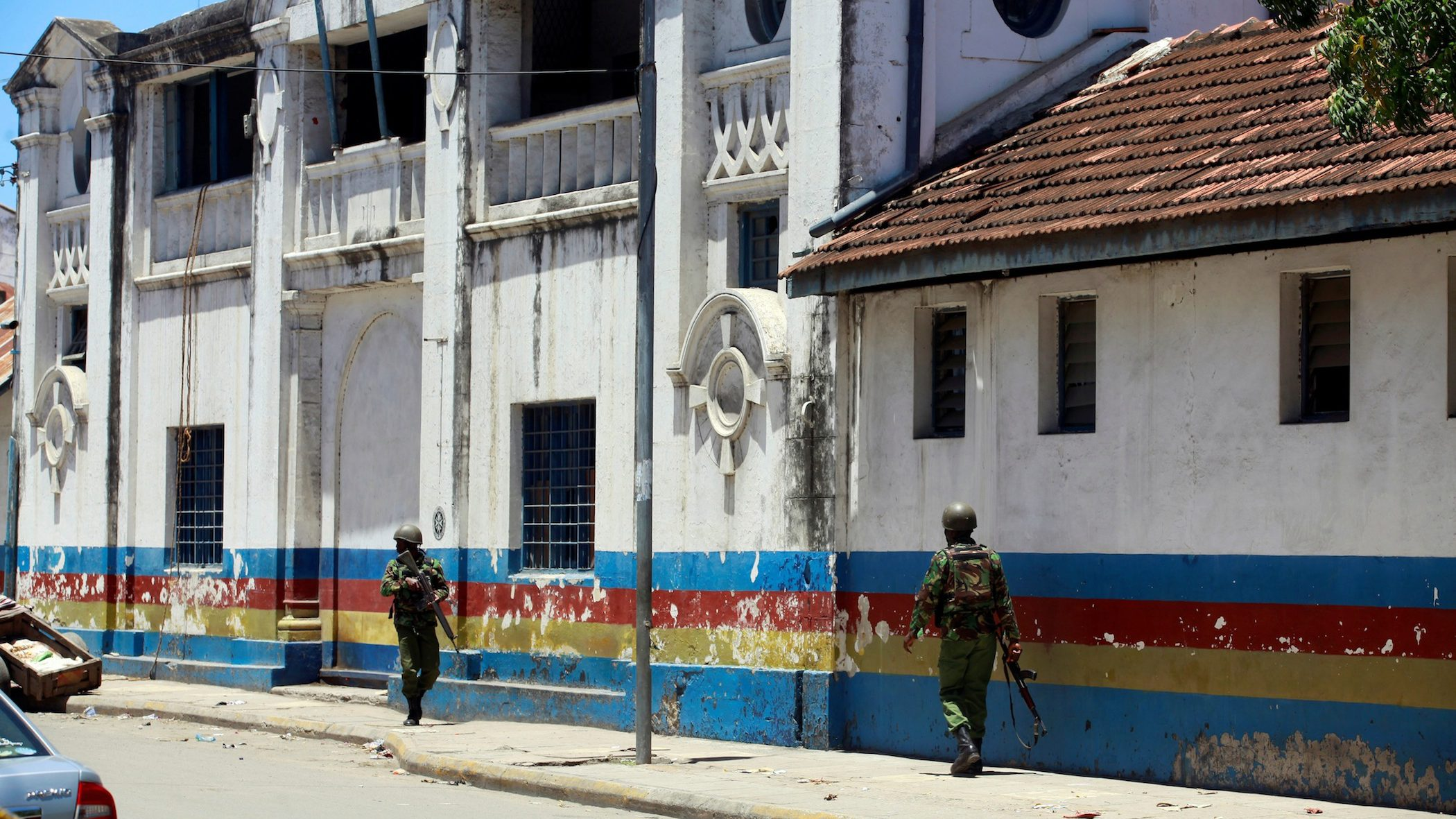Armed policemen walk outside the central police station after an attack, in the coastal city of Mombasa, Kenya, September 11, 2016.