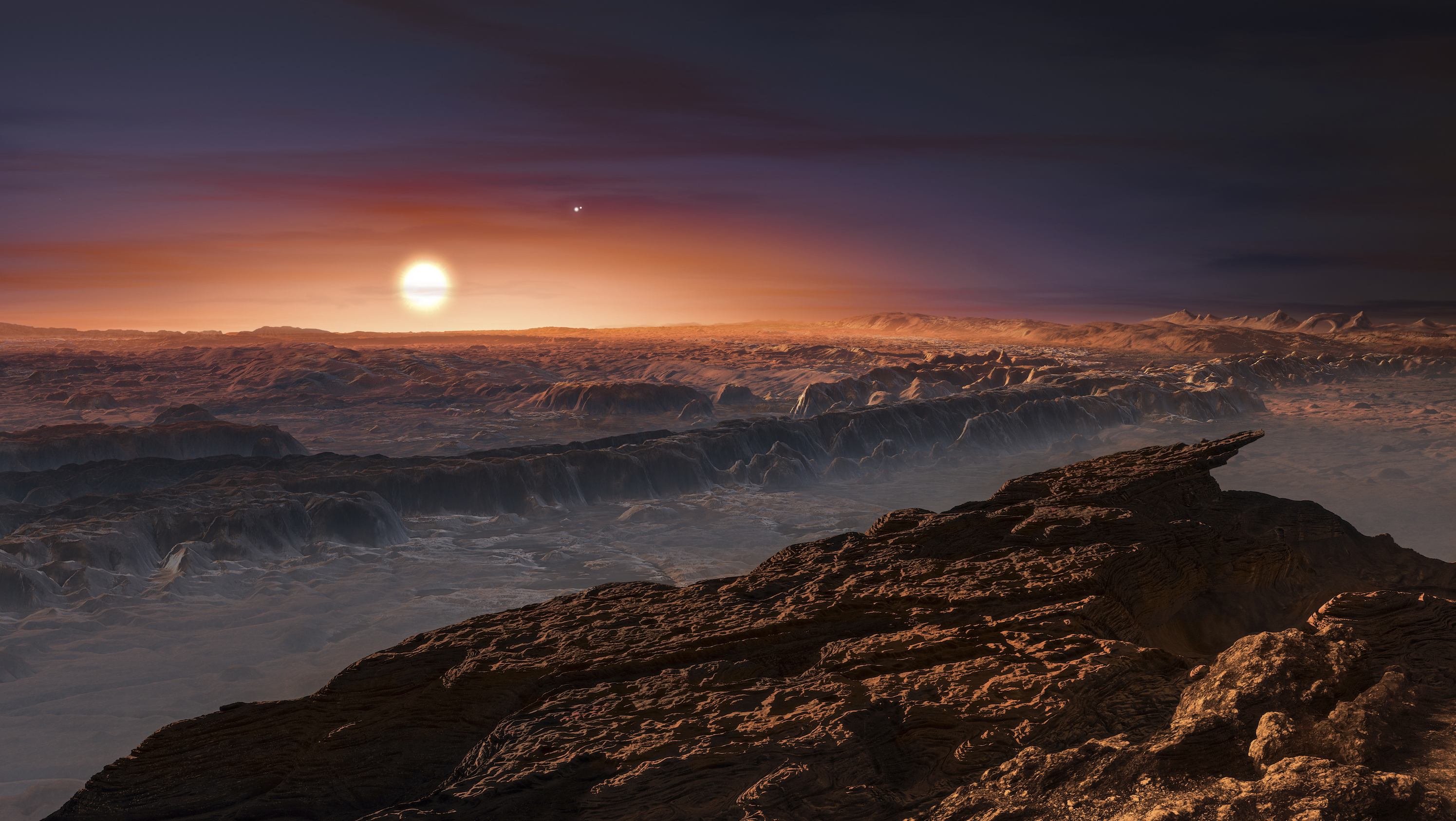 A view of the surface of the planet Proxima b orbiting the red dwarf star Proxima Centauri, the closest star to our Solar System, is seen in an undated artist's impression