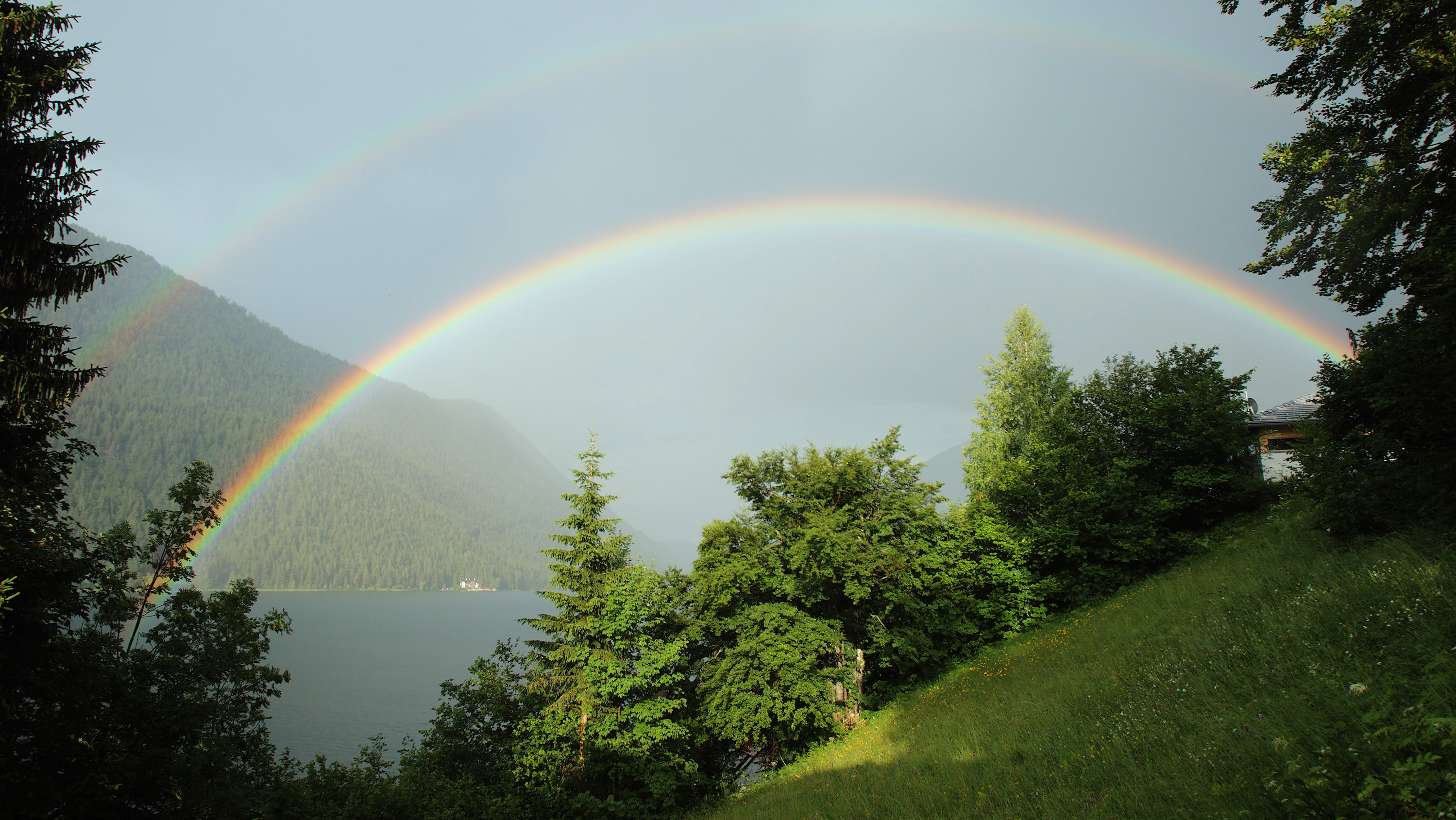 A double rainbow appears above Lake Weissensee in Naggl in Austria's southern Carinthia province