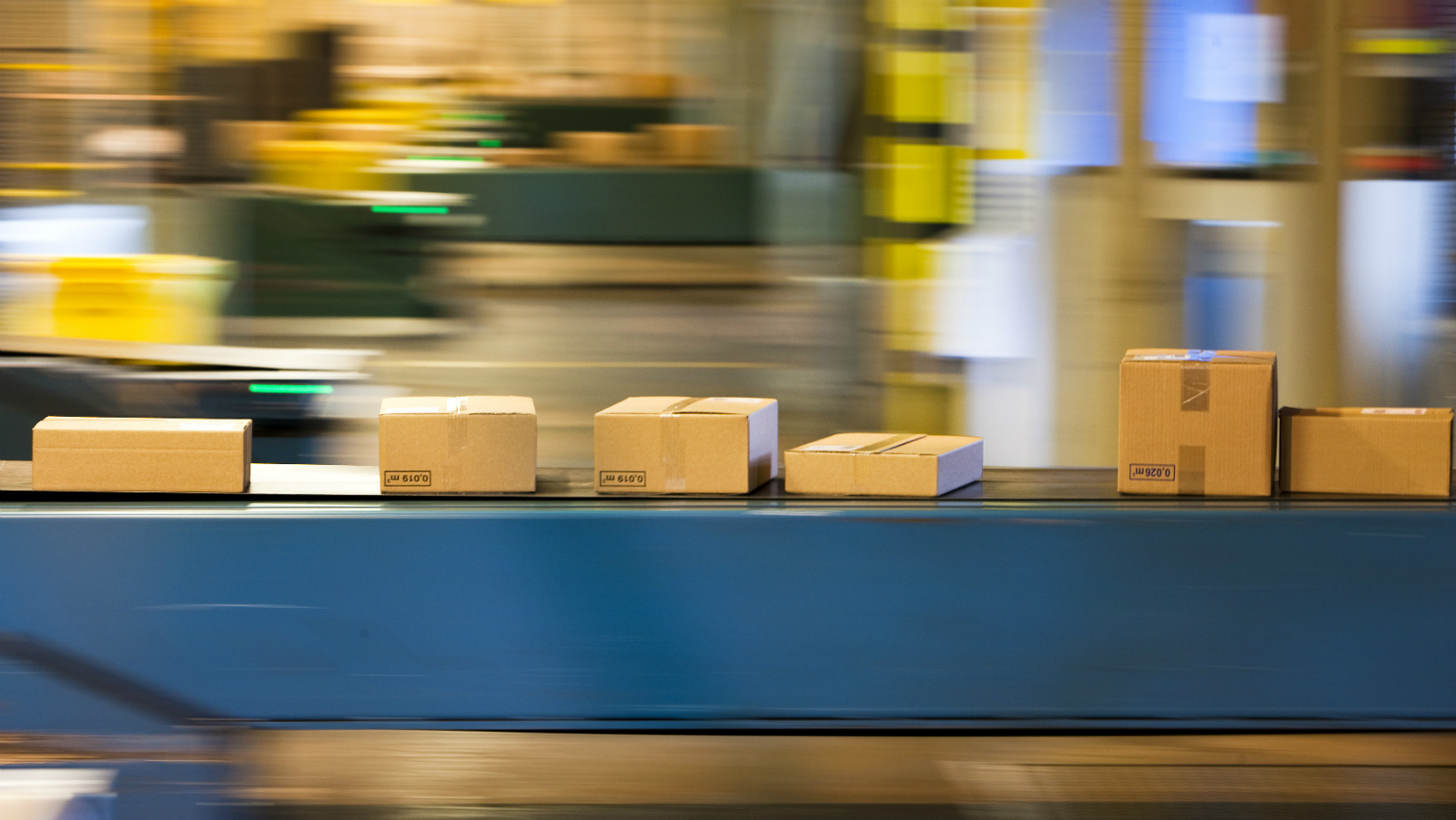 Parcels travel on a conveyer belt before being sorted for delivery in one of the three main Swiss post logistic hubs in Daillens near Lausanne, November 9, 2010. The Swiss post parcels logistics centre in Daillens handles an average of 135,000 parcels a day.