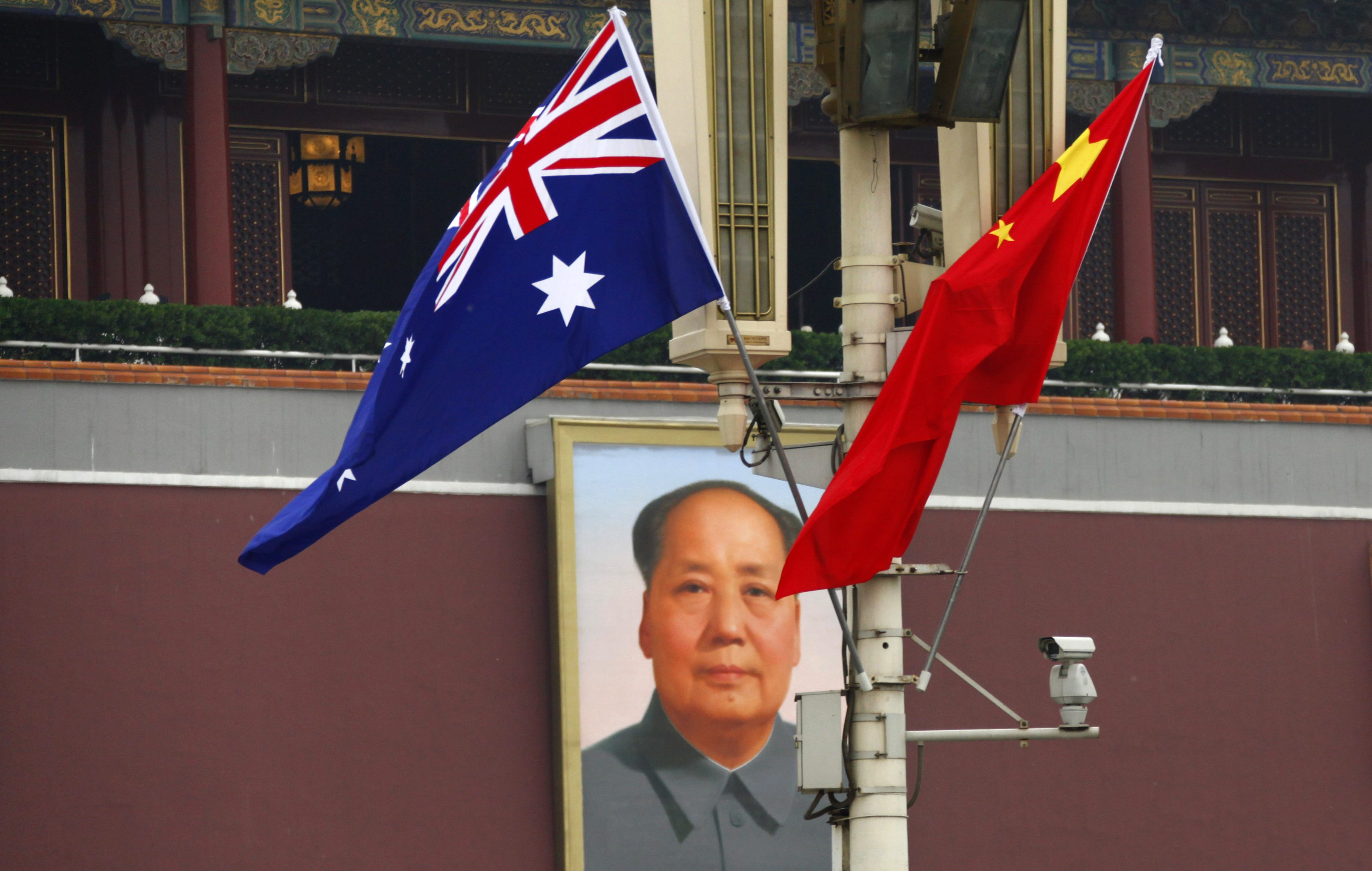 The Australian national flag flies next to the Chinese national flag in front of the giant portrait of former Chairman Mao Zedong on Tiananmen Square in Beijing, April 25, 2011.