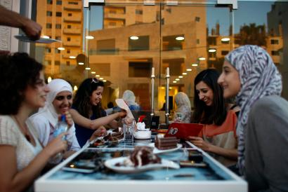 Palestinian women sit together at a newly opened upscale Italian cafe in the West Bank city of Ramallah