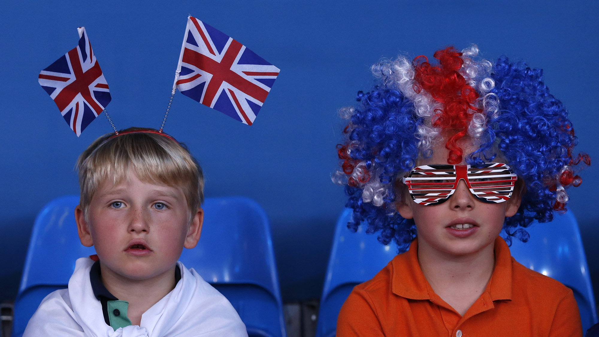 Young spectators watch the men's -81kg and women's 63kg judo competition at the London 2012 Olympic Games July 31, 2012.               REUTERS/Kim Kyung-Hoon (BRITAIN  - Tags: SPORT OLYMPICS SPORT JUDO) - RTR35QC3