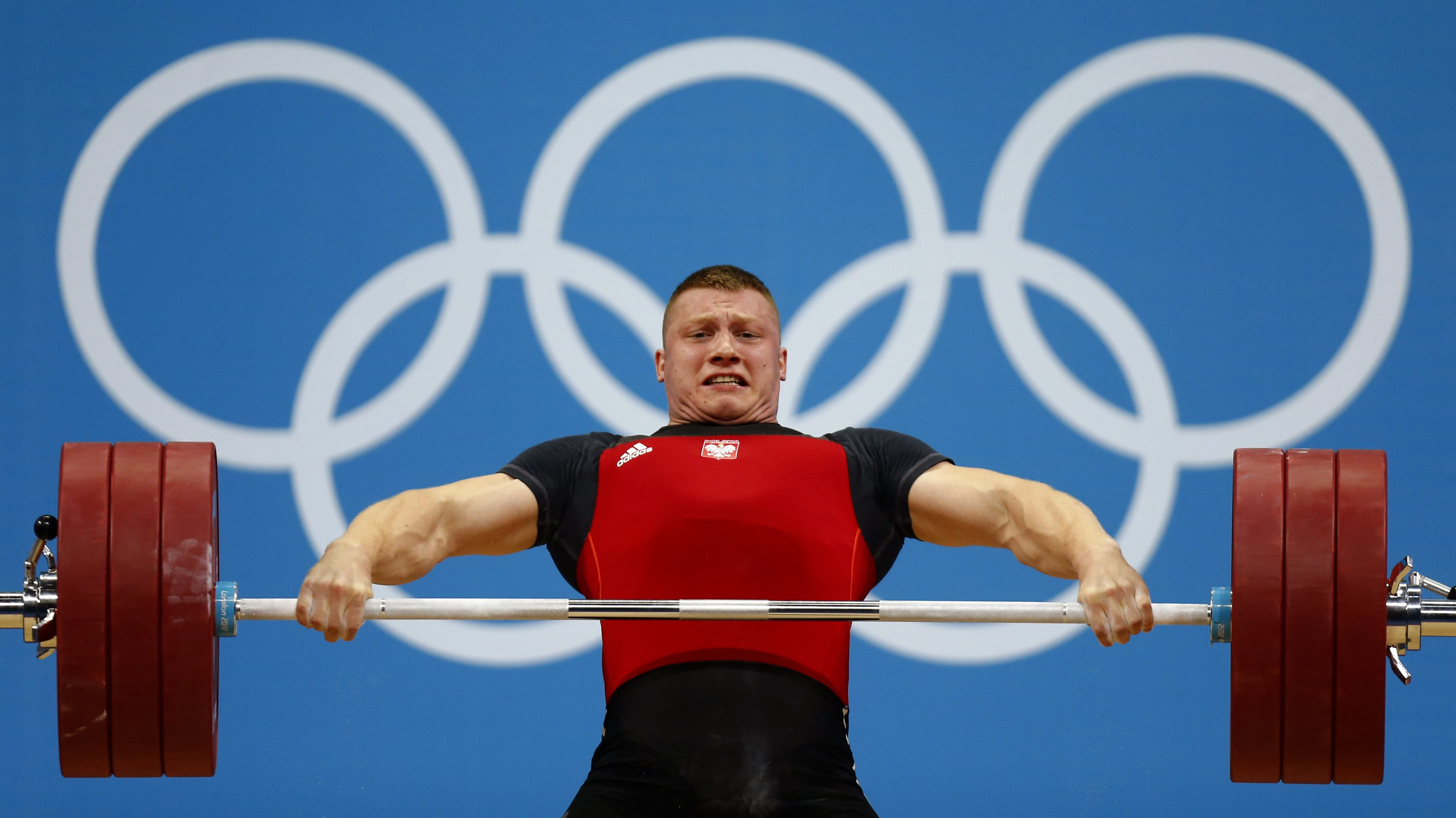 Poland's Tomasz Bernard Zielinski lifts on the men's 94Kg group B weightlifting competition at the ExCel venue at the London 2012 Olympic Games