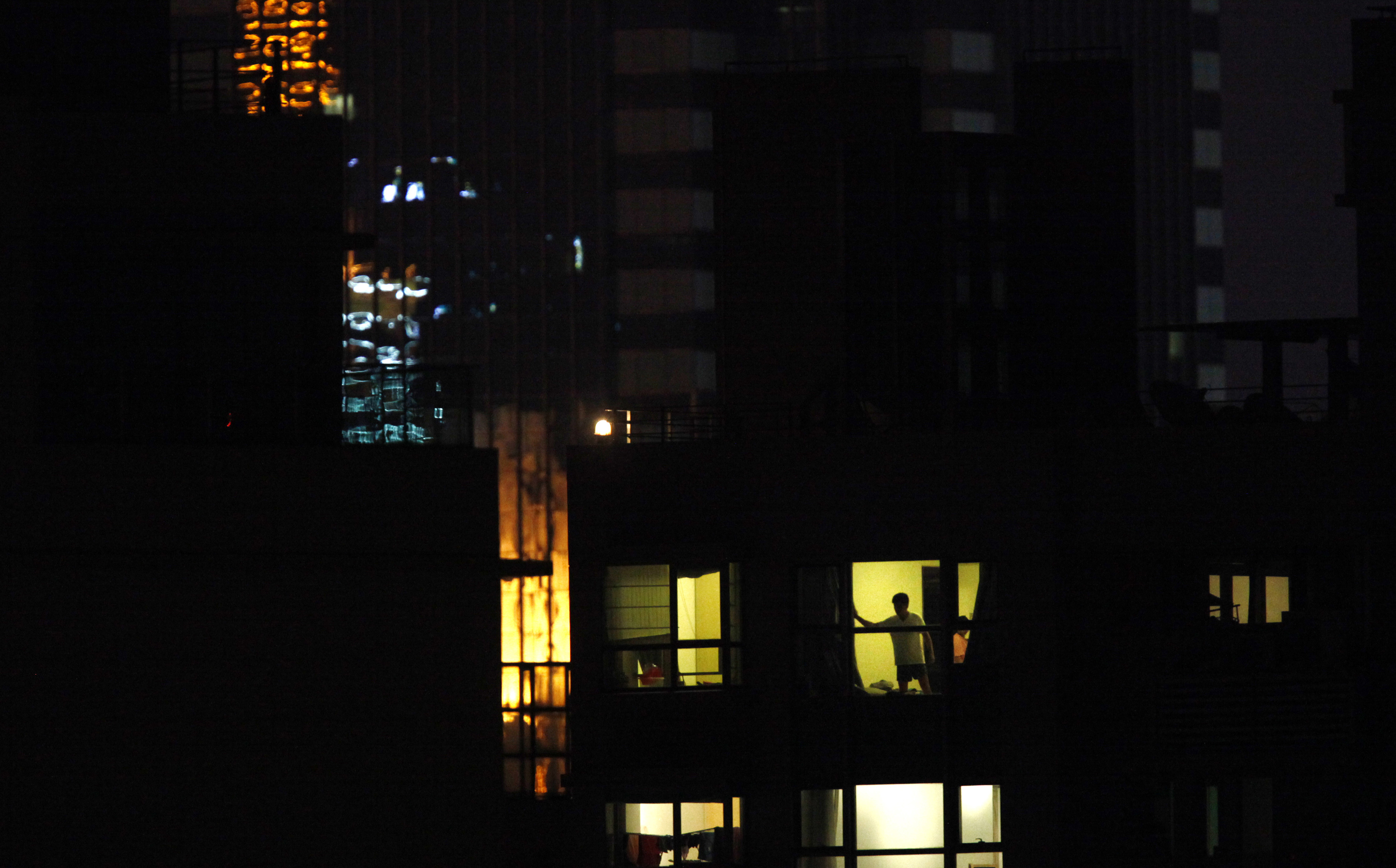 man stands at apartment window