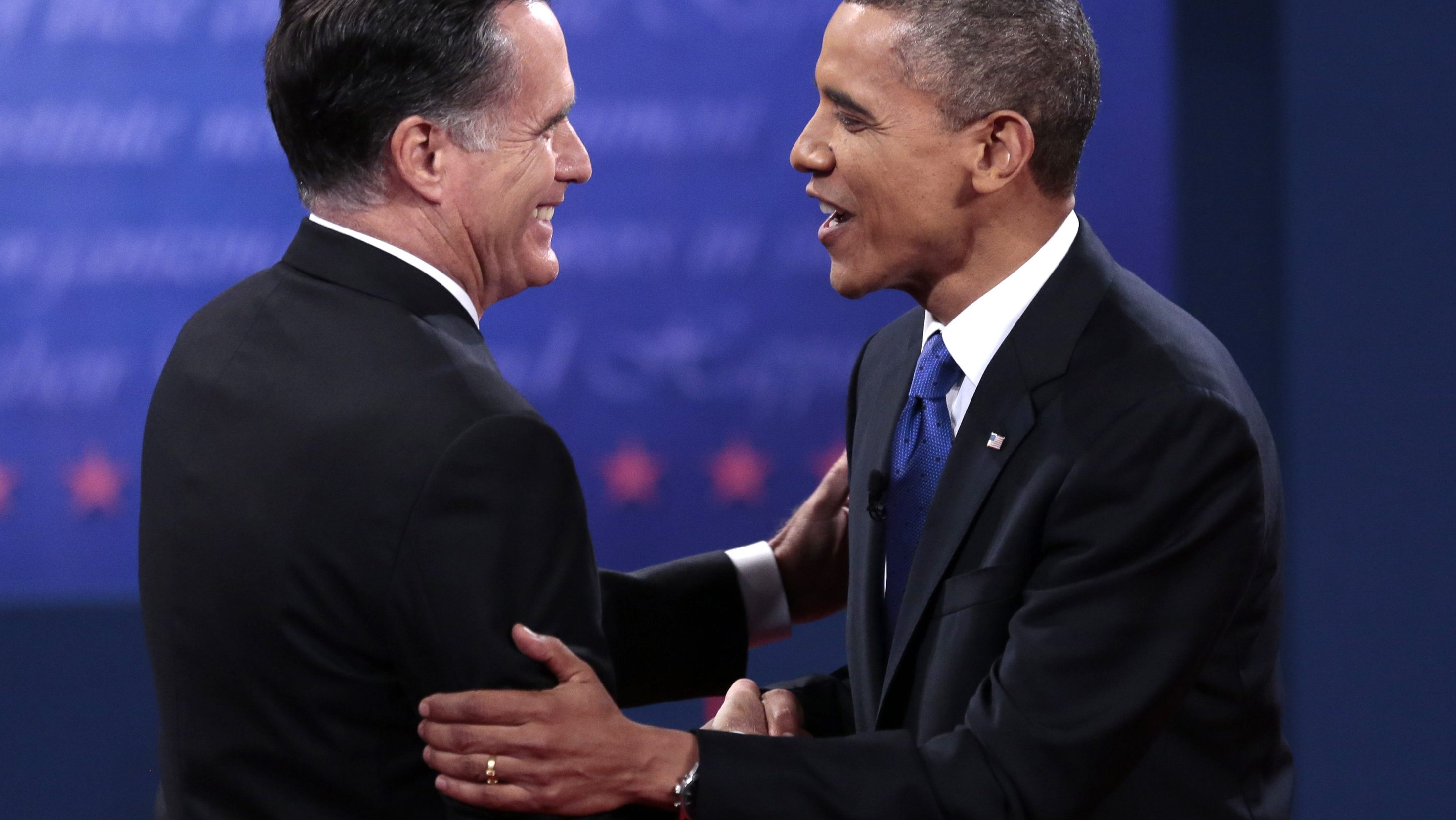 U.S. Republican presidential nominee Romney and U.S. President Obama shake hands at the conclusion of the final U.S. presidential debate in Boca Raton