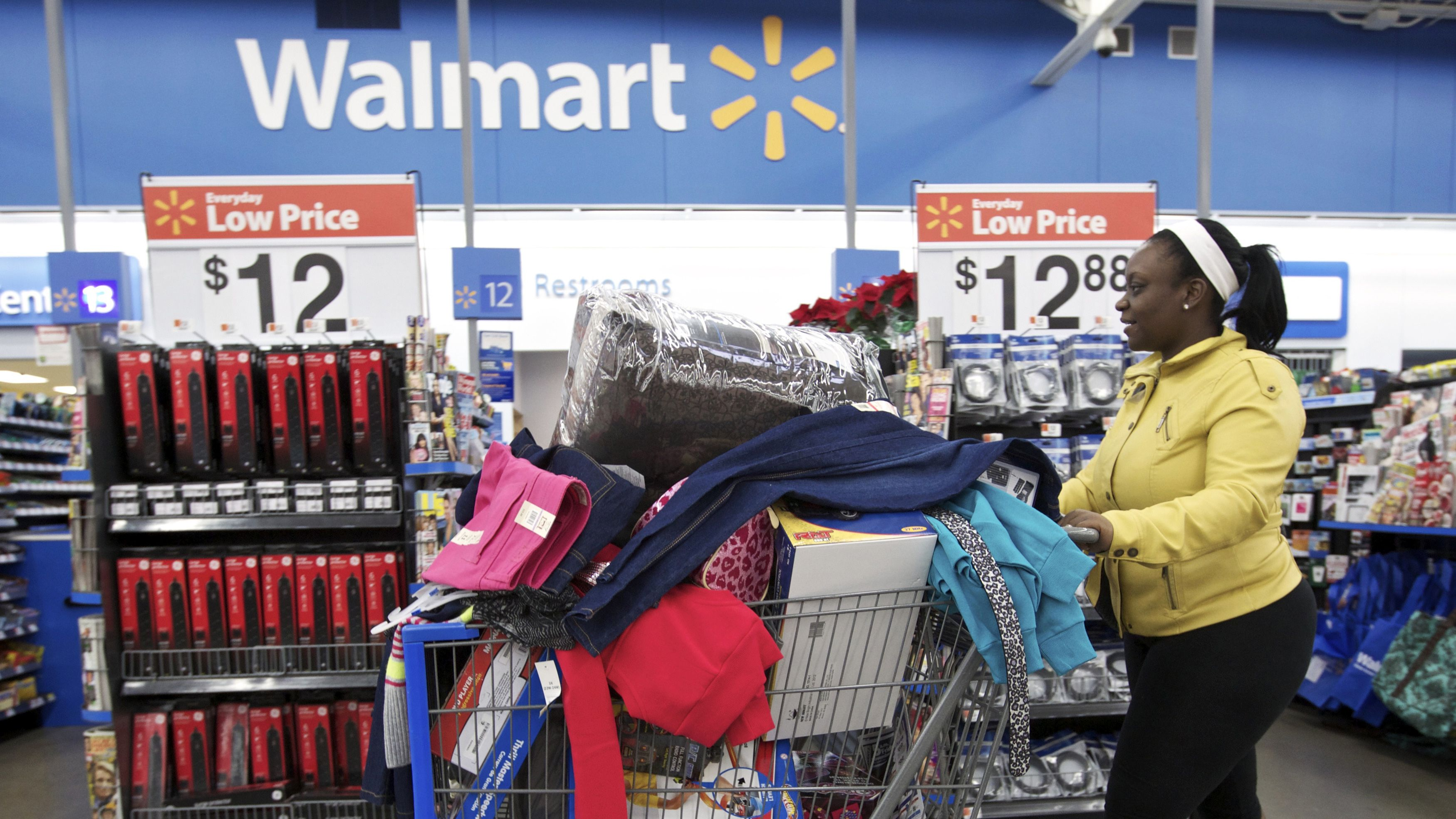 Tasha heads to checkout at a Walmart Store in Chicago, November 23, 2012. Black Friday, the day following the Thanksgiving Day holiday, has traditionally been the busiest shopping day in the United States.
