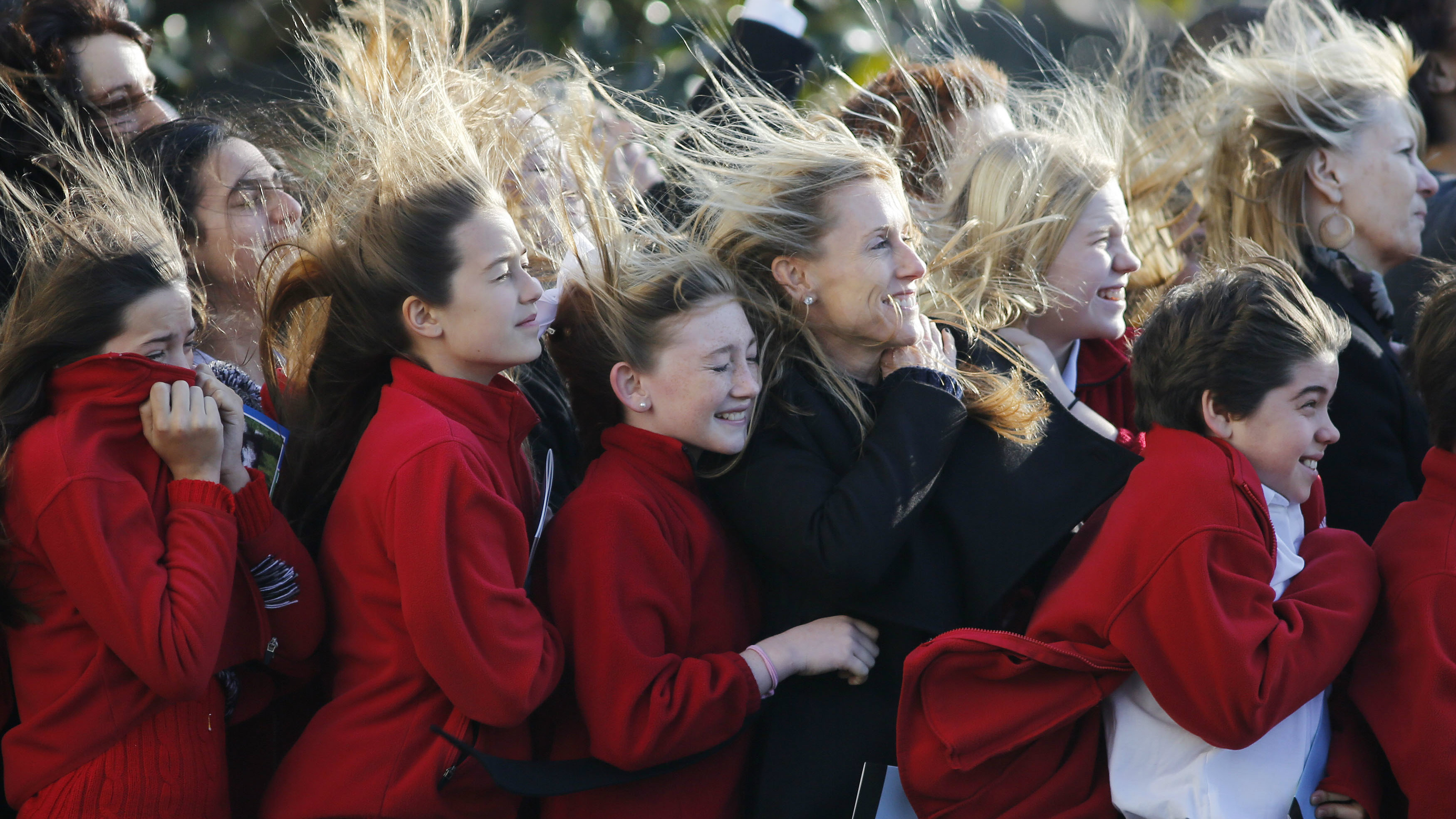 Students from the Park Maitland School watch as Marine One carrying Obama takes off from the South Lawn...