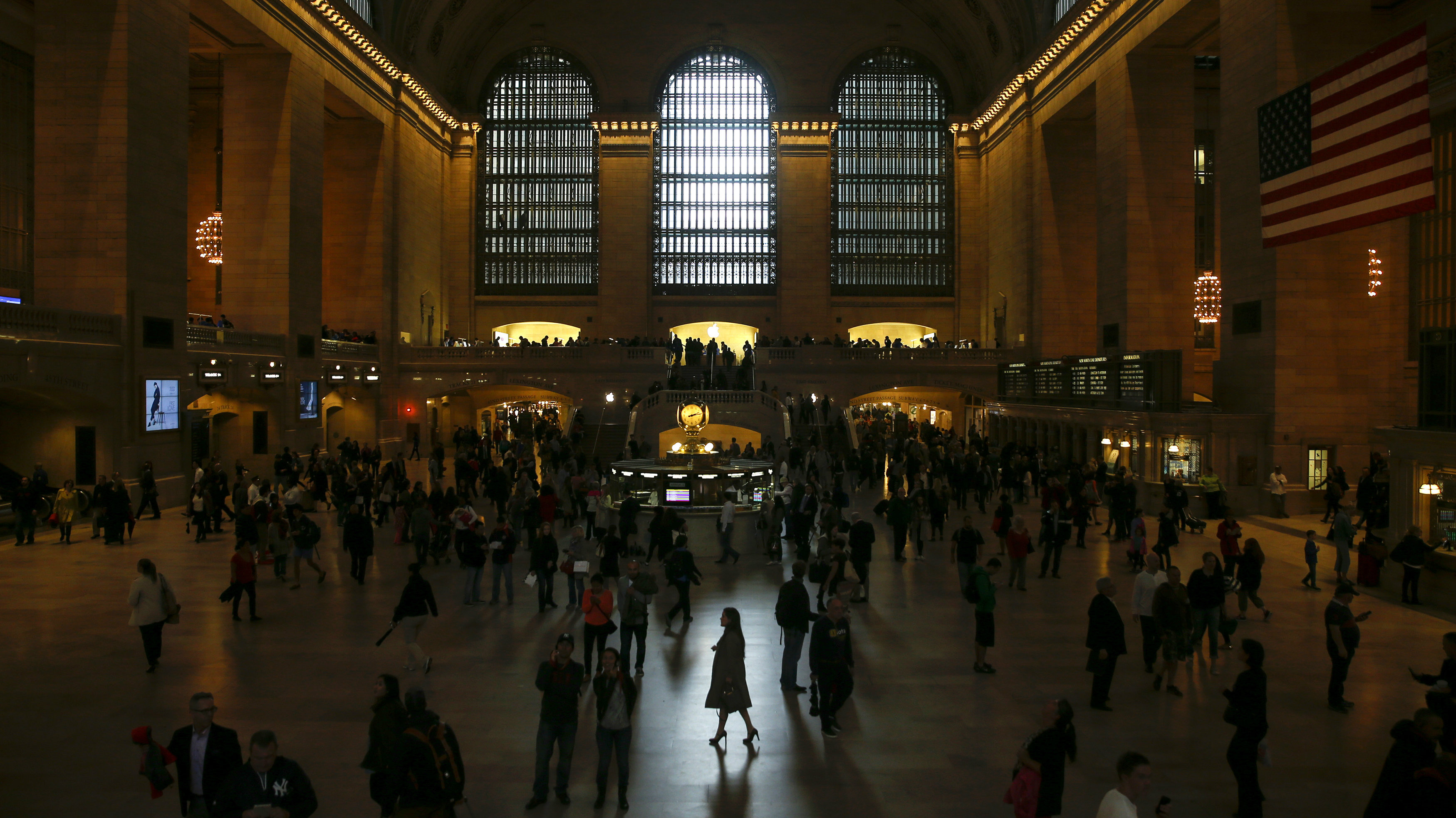 A woman is seen in silhouette walking through Grand Central Station in New York.