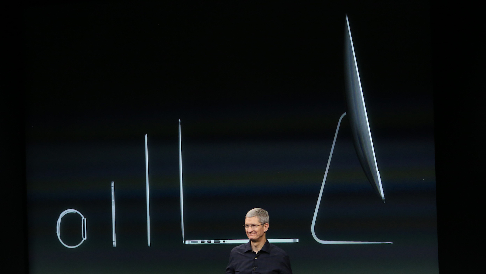 Apple CEO Tim Cook speaks during a presentation at Apple headquarters in Cupertino, California October 16, 2014.  REUTERS/Robert Galbraith (UNITED STATES  - Tags: SCIENCE TECHNOLOGY BUSINESS)   - RTR4AH2E