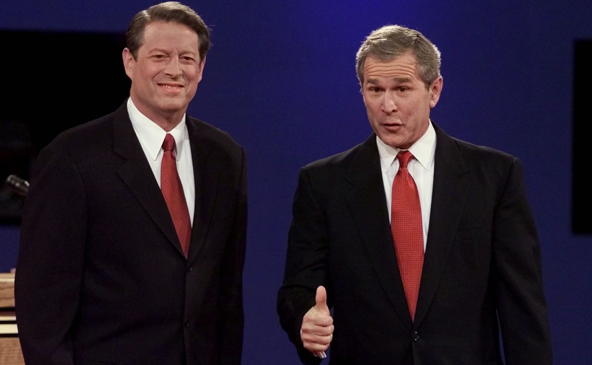 Texas Governor and Republican presidential candidate George W. Bush gives a thumbs-up before the start of the first presidential debate with Democratic presidential candidate Vice President Al Gore (L) prior to the start of the debate at the University of Massachusetts in Boston, October 3, 2000. Today marks the first of three presidential debates leading up to the November 7 U.S. elections.
