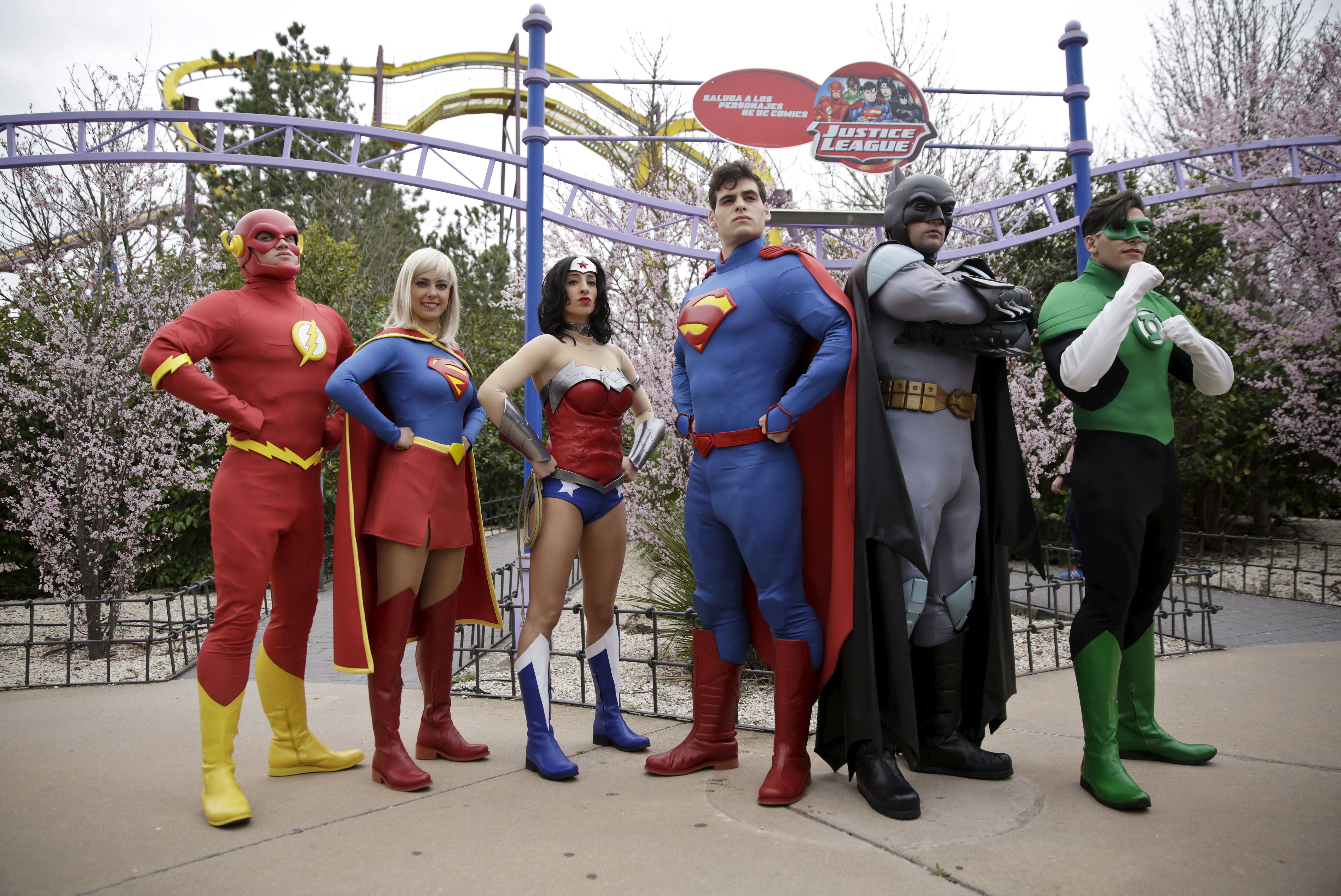 Actors dressed as members of the Justice League pose during the season inauguration of the Madrid Warner amusement park in San Martin de Valdeiglesias near Madrid