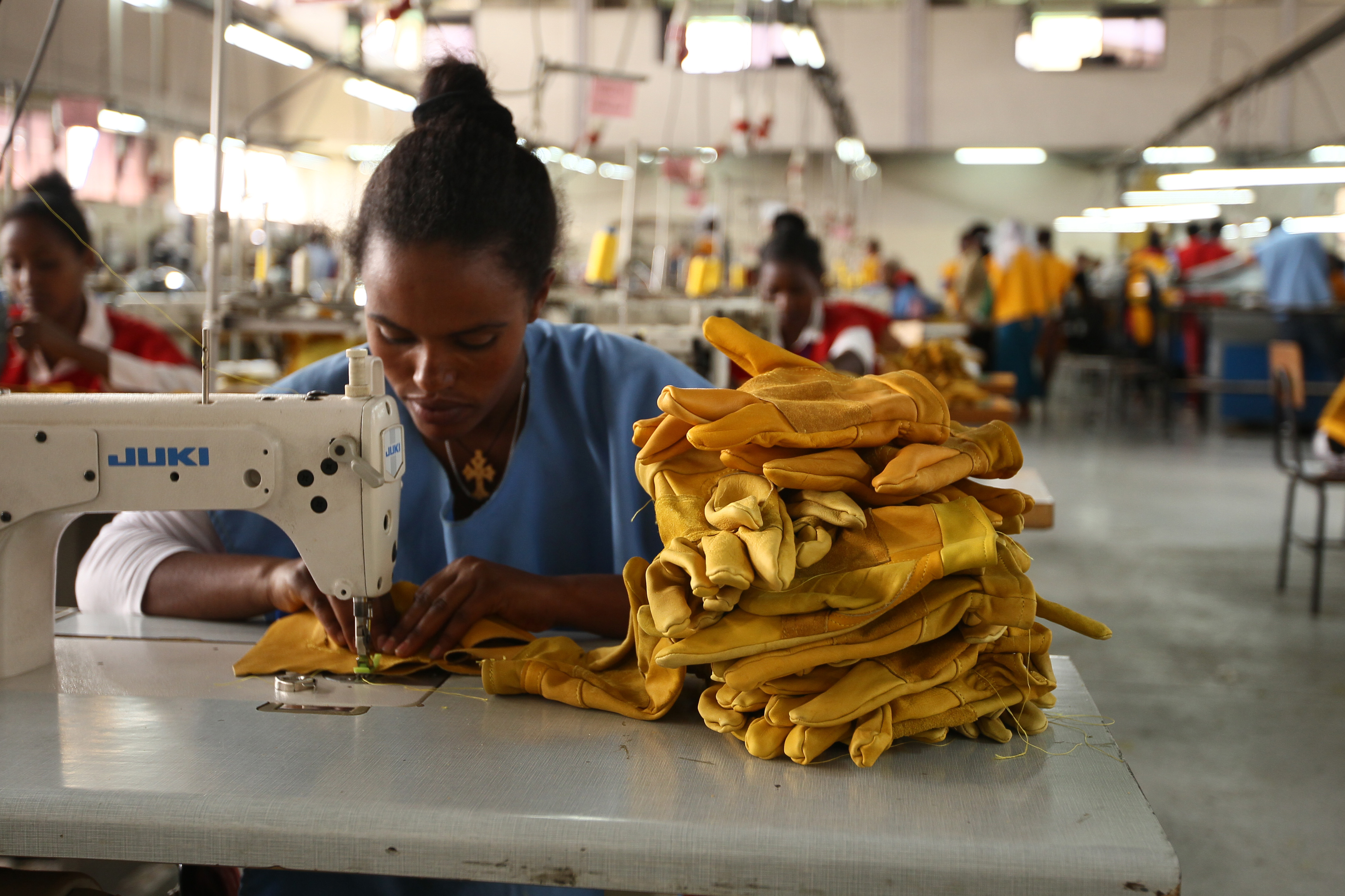 A woman stitches leather gloves at the Pittards world class leather manufacturing company in Ethiopia's capital Addis Ababa