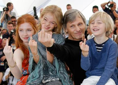 """Cast members Viggo Mortensen, Charlie Shotwell, Shree Crooks and Annalise Basso gesture during a photocall for the film """"Captain Fantastic"""" in competition in """"Un Certain Regard"""" at the 69th Cannes Film Festival in Cannes"""