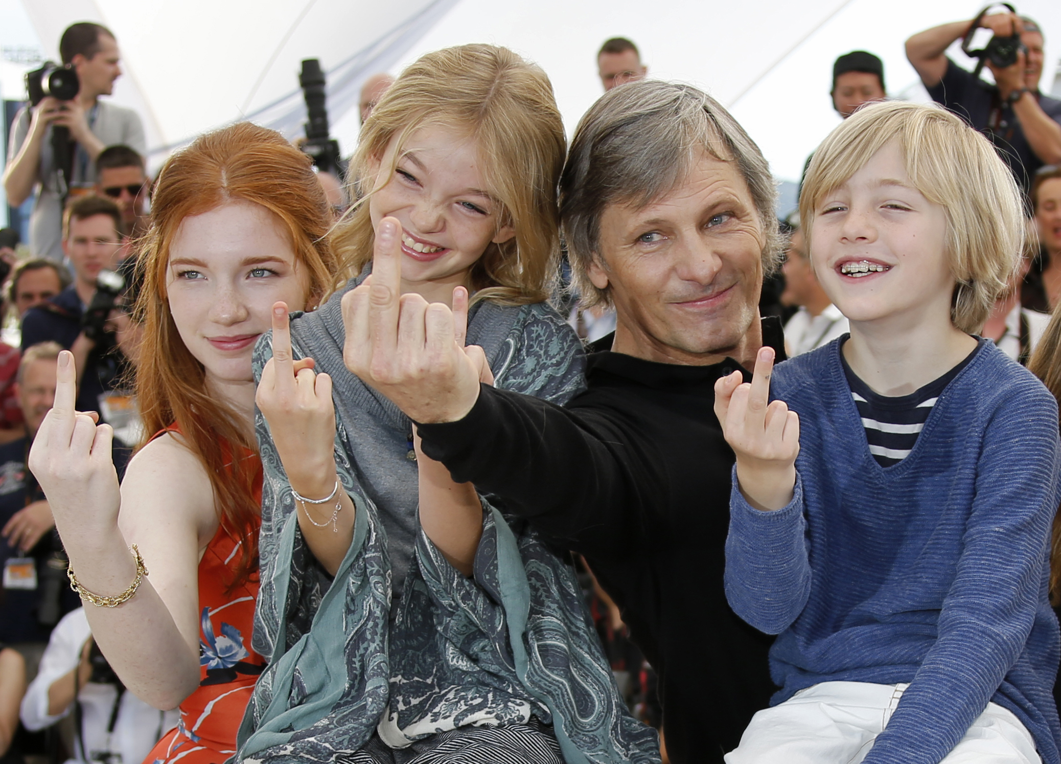 """Giving the finger -- Viggo Mortensen, Charlie Shotwell, Shree Crooks and Annalise Basso gesture during a photocall for the film """"Captain Fantastic"""" in the 69th Cannes Film Festival in Cannes"""